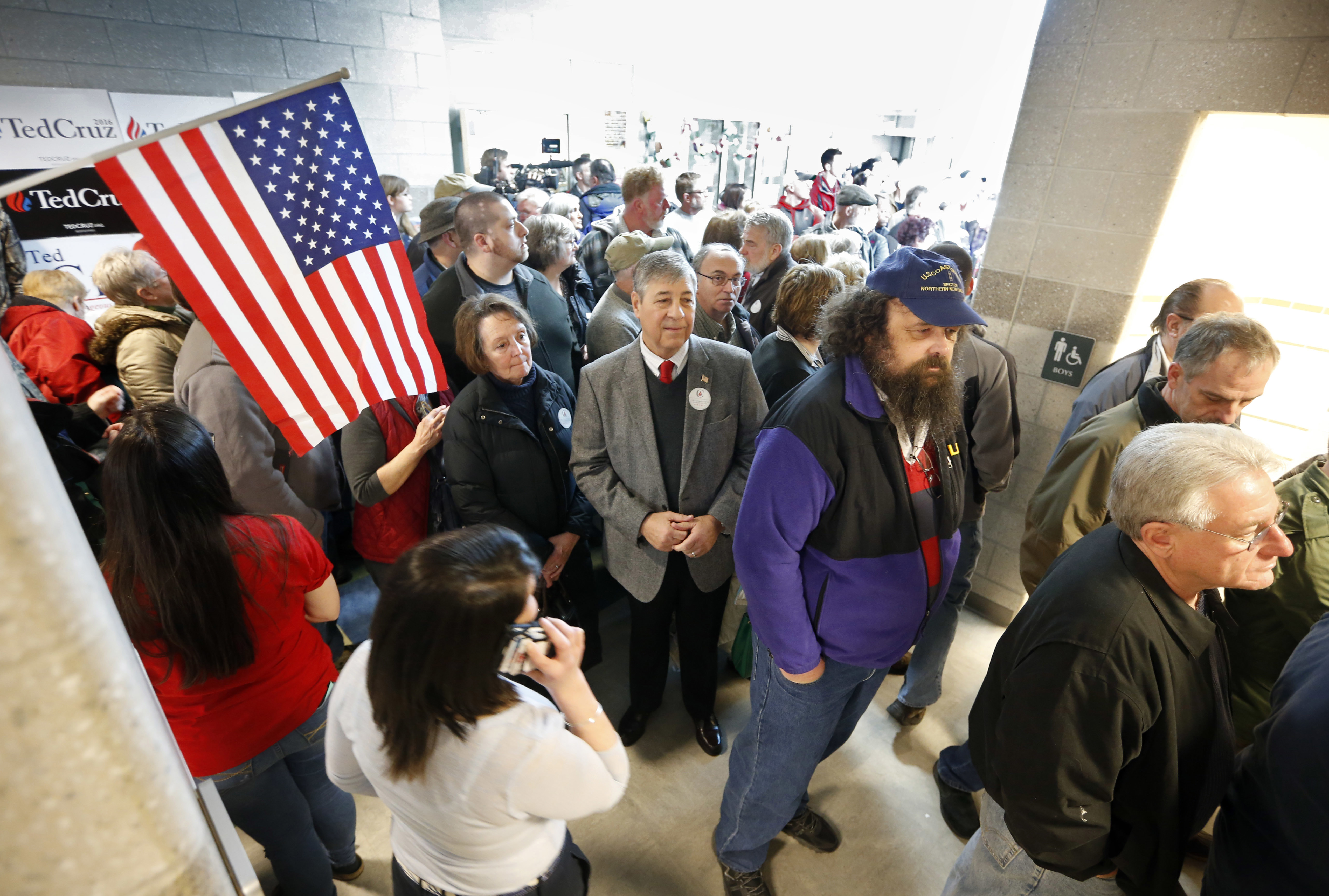 An overflow crowd waits to get into the gymnasium at Chelsea Elementary School to cast their votes at a Republican caucus in Chelsea, Maine, March 5, 2016.
