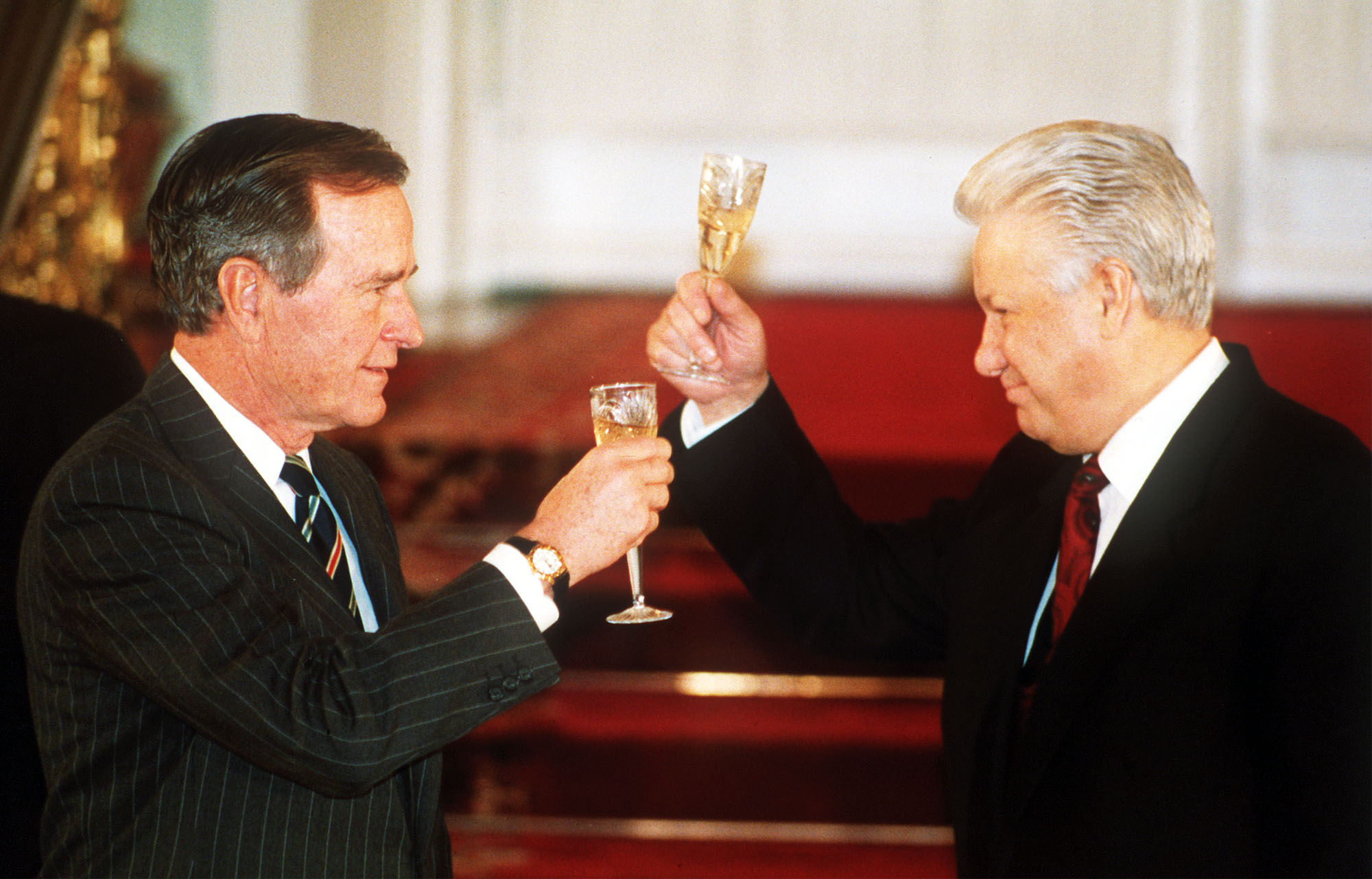 This January 3, 1993 photo shows then Russian President Boris Yeltsin toasting with then U. S. President George H. W. Bush after they signed the START II treaty in Moscow.