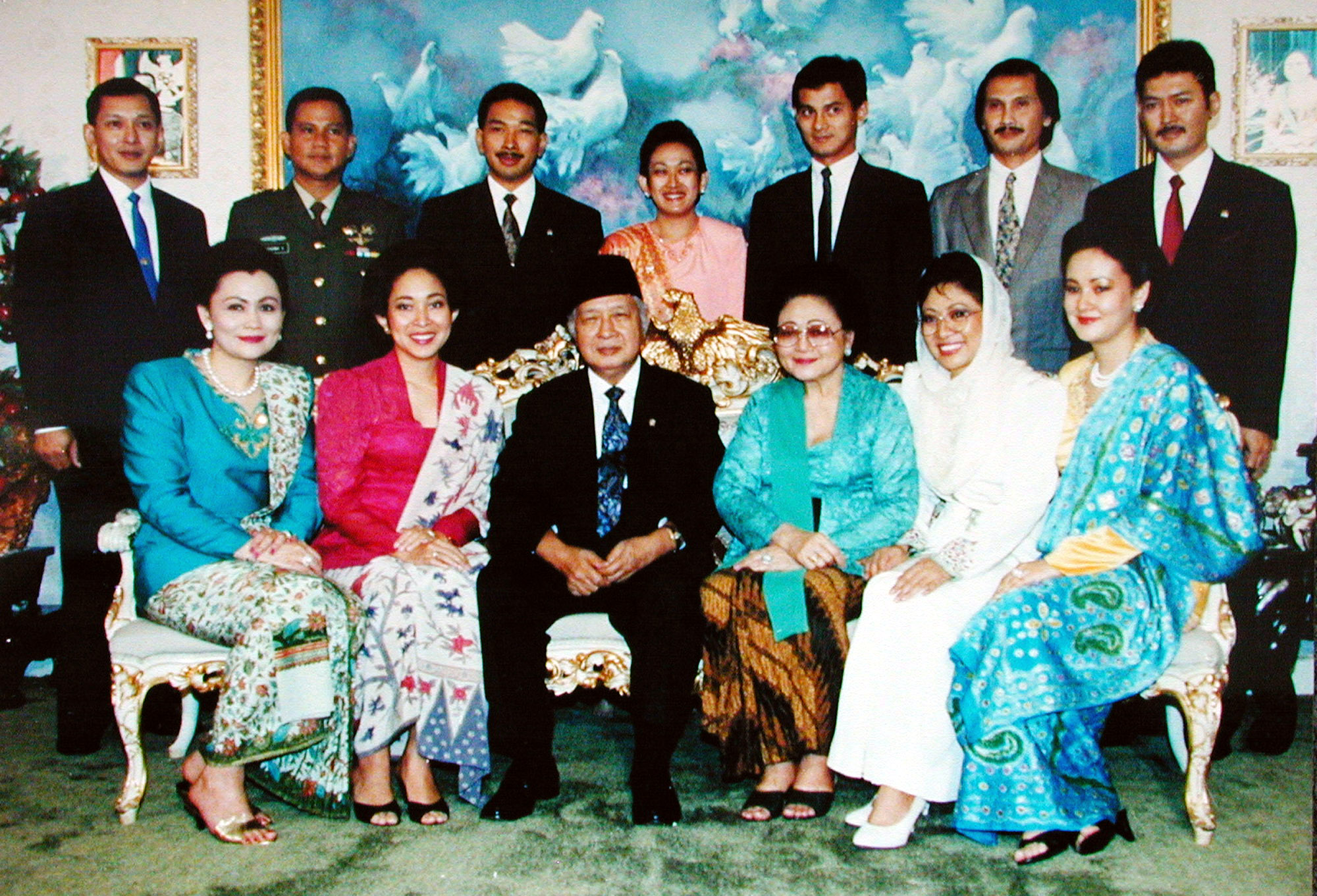 """FILE - Hutomo Mandala Putra, popularly known as """"Tommy"""", top row third from left, youngest son of former Indonesian President Suharto, bottom row third left, is pictured in this undated family photo in Jakarta, Indonesia."""