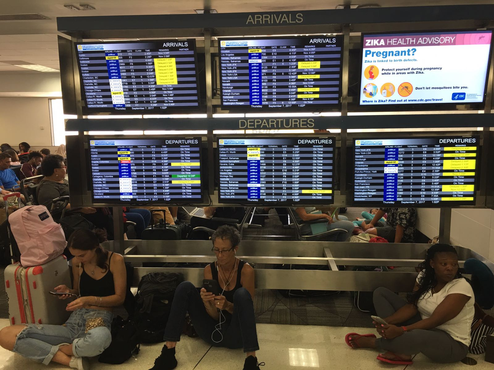 Stranded travelers at the Fort Lauderdale, Florida, airport look for ways to get out of the state in anticipation of Hurricane Irma's arrival, expected to hit the area this weekend, Sept. 7, 2017.