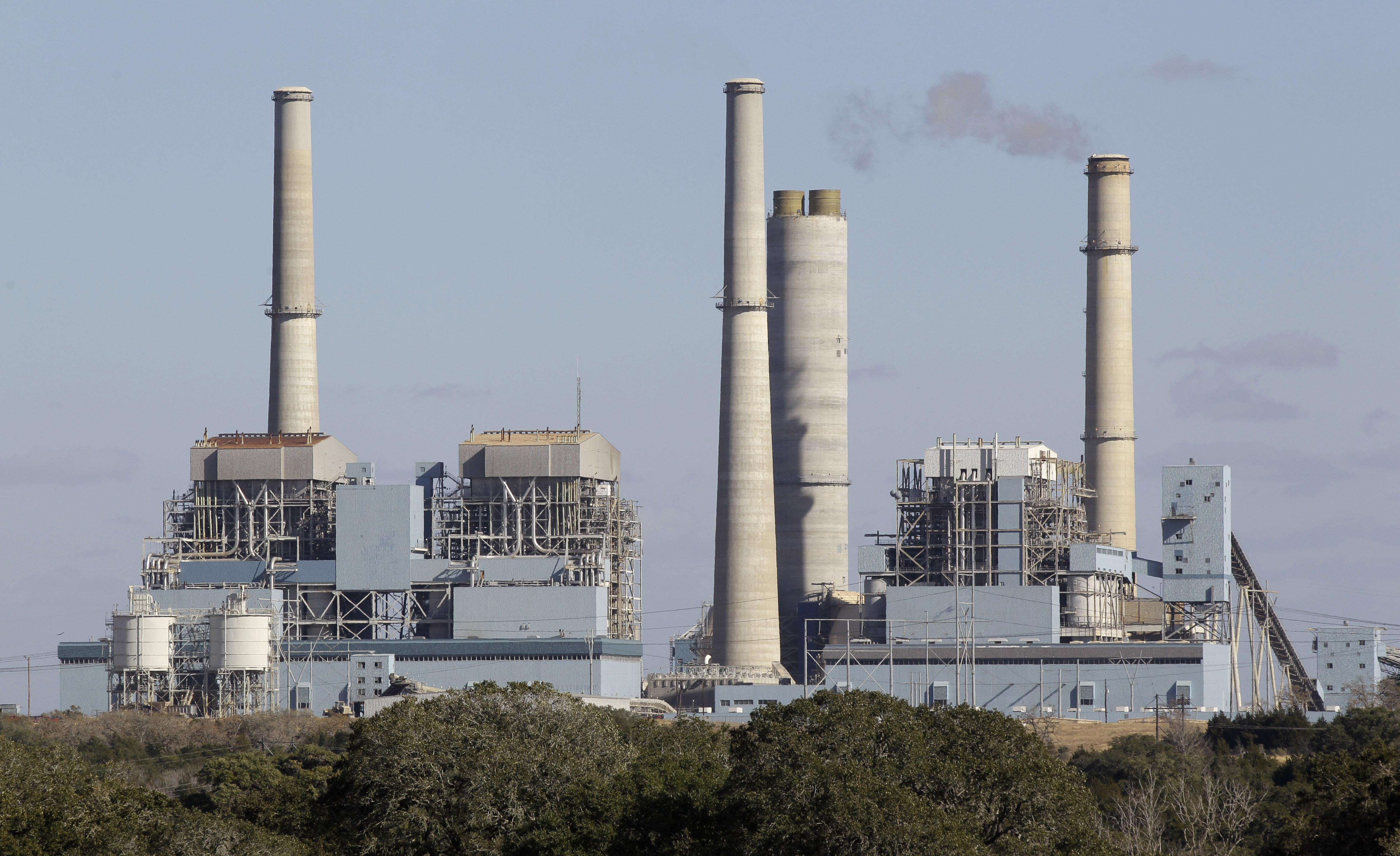 FILE- The Fayette Power Project, a coal-fired power plant, is shown in Ellinger, Texas, Dec. 15, 2010. Some environmentalists, ranchers and scientists linked tree deaths in the area to sulfur dioxide emissions from the plant.