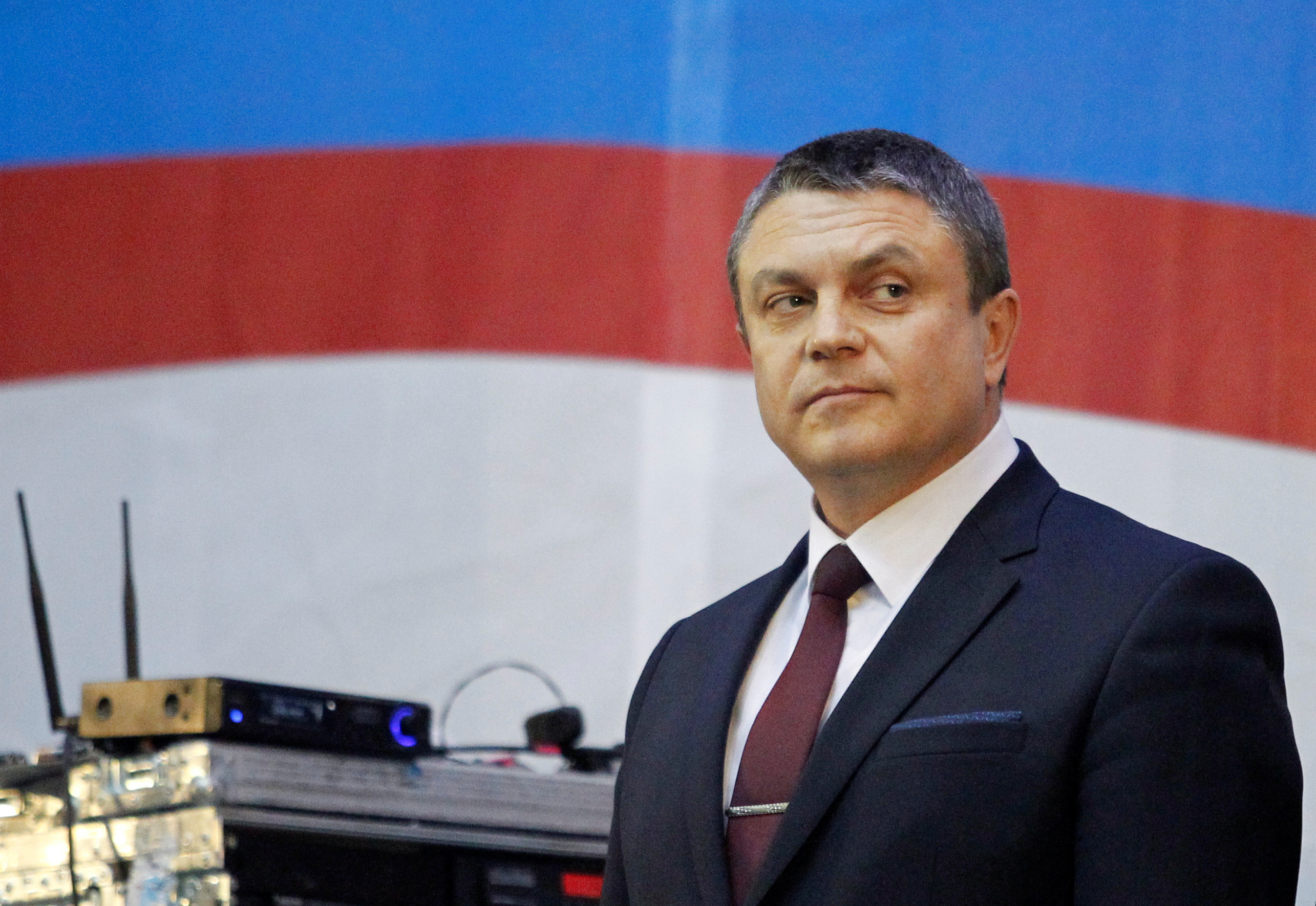 FILE - Acting head of the self-proclaimed separatist Luhansk People's Republic (LNR) Leonid Pasechnik stands on the stage during his pre-election address ahead of the upcoming vote for a new leader in Luhansk, Ukraine, Nov. 8, 2018.