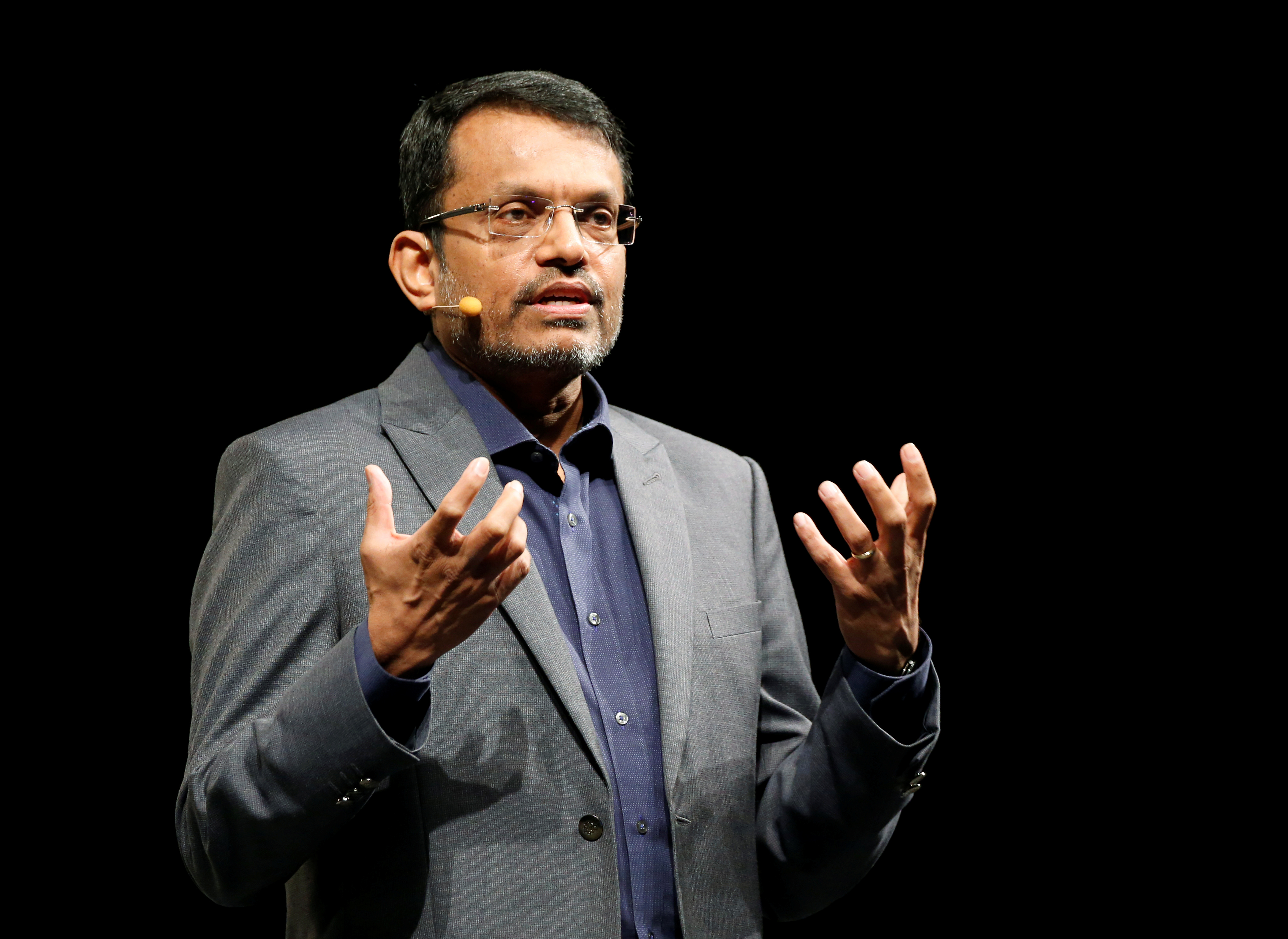 FILE - Ravi Menon, managing director of the Monetary Authority of Singapore (MAS), speaks at the Singapore Fintech Festival in Singapore Nov. 16, 2016.