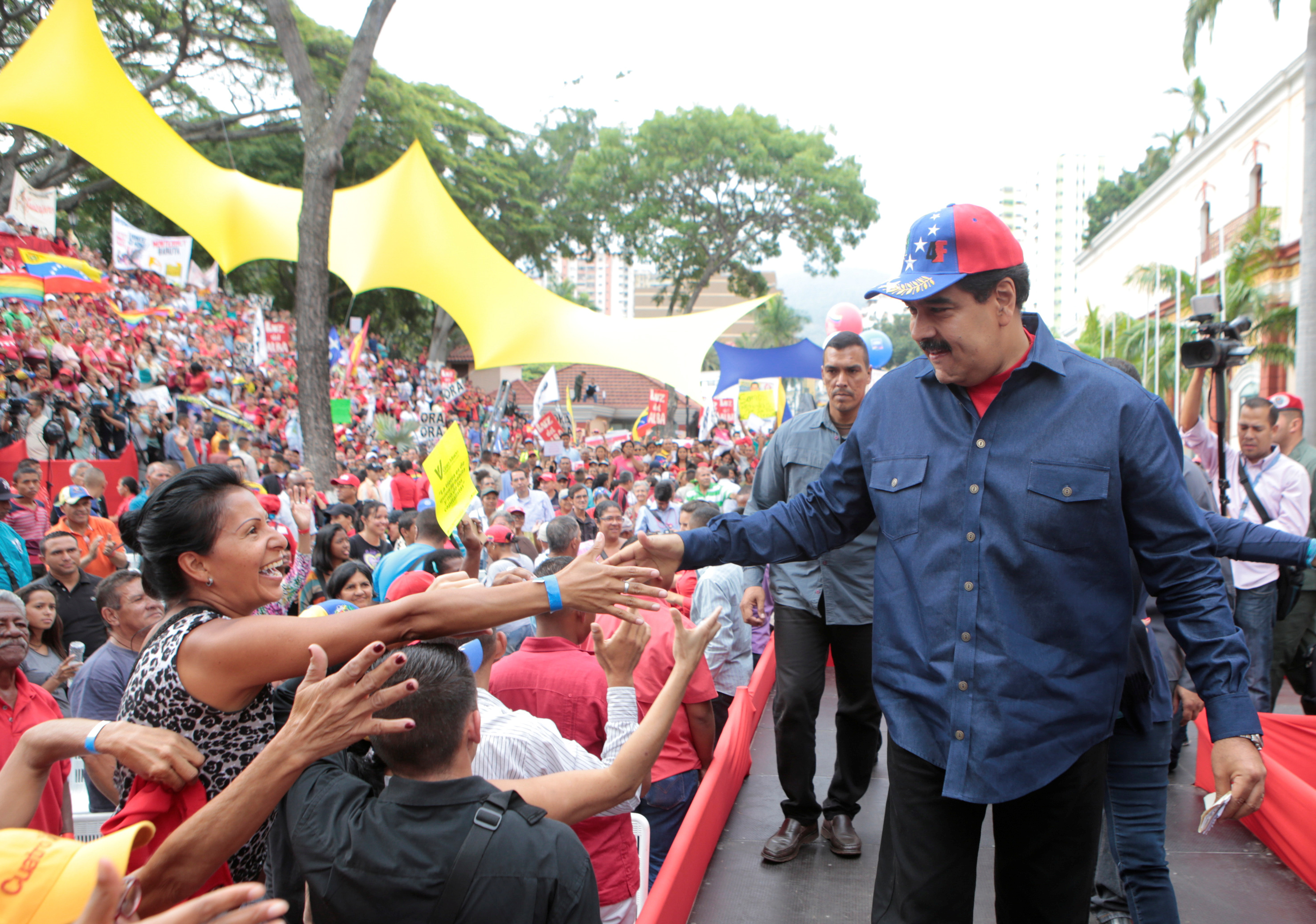 Venezuela's President Nicolas Maduro greets supporters during a rally in support of the Venezuelan government's housing programs at Miraflores Palace in Caracas, Venezuela, May 11, 2016.