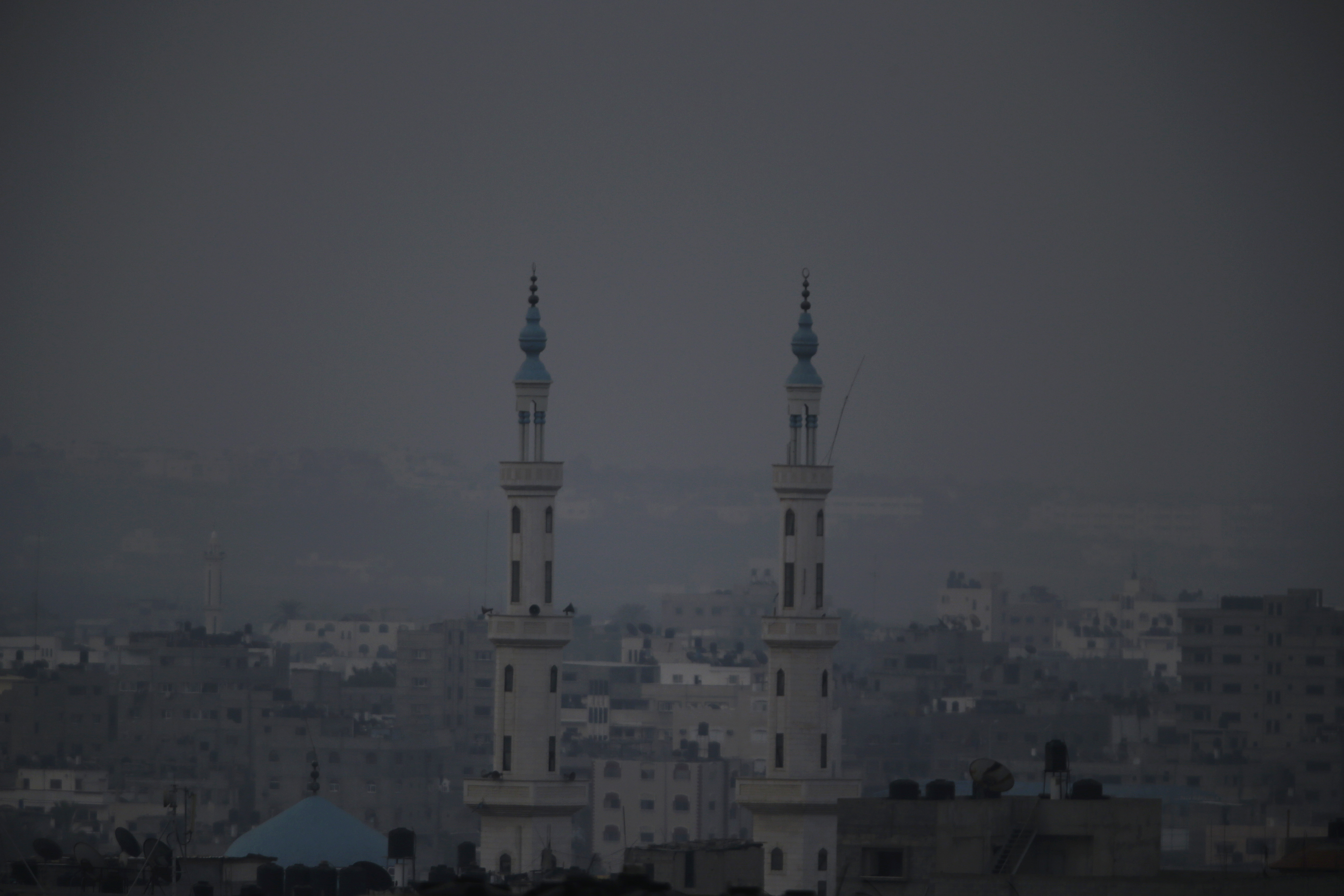 Monday marked the beginning of the three-day Eid al-Fitr holiday, which caps the Muslim fasting month of Ramadan. Minarets from a mosque are seen in this view of Gaza city, July 28, 2014.