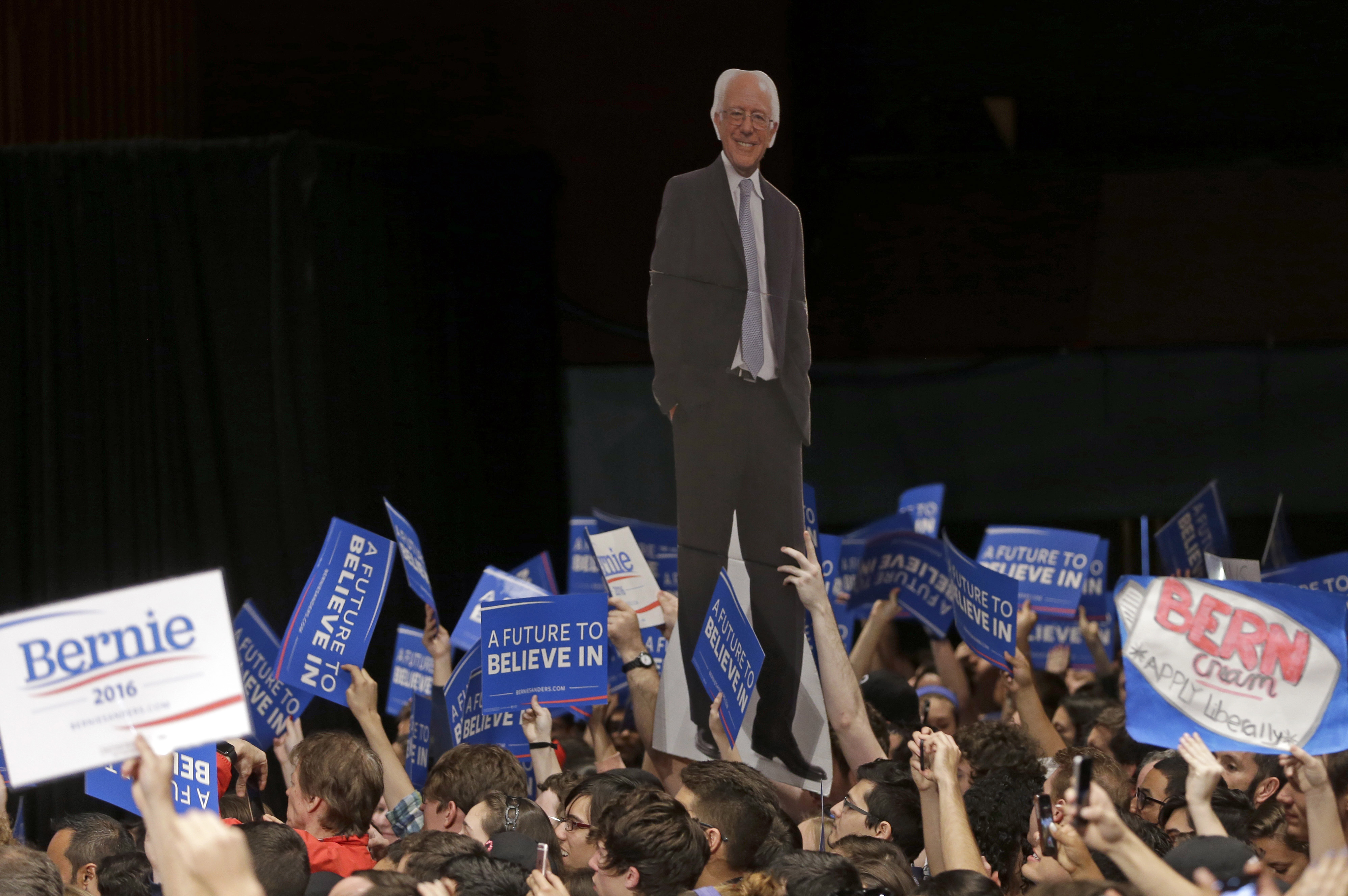 Supporters display a cardboard cutout of Democratic presidential candidate, Sen. Bernie Sanders, I-Vt., at a campaign rally in Miami, Florida, March 8, 2016.