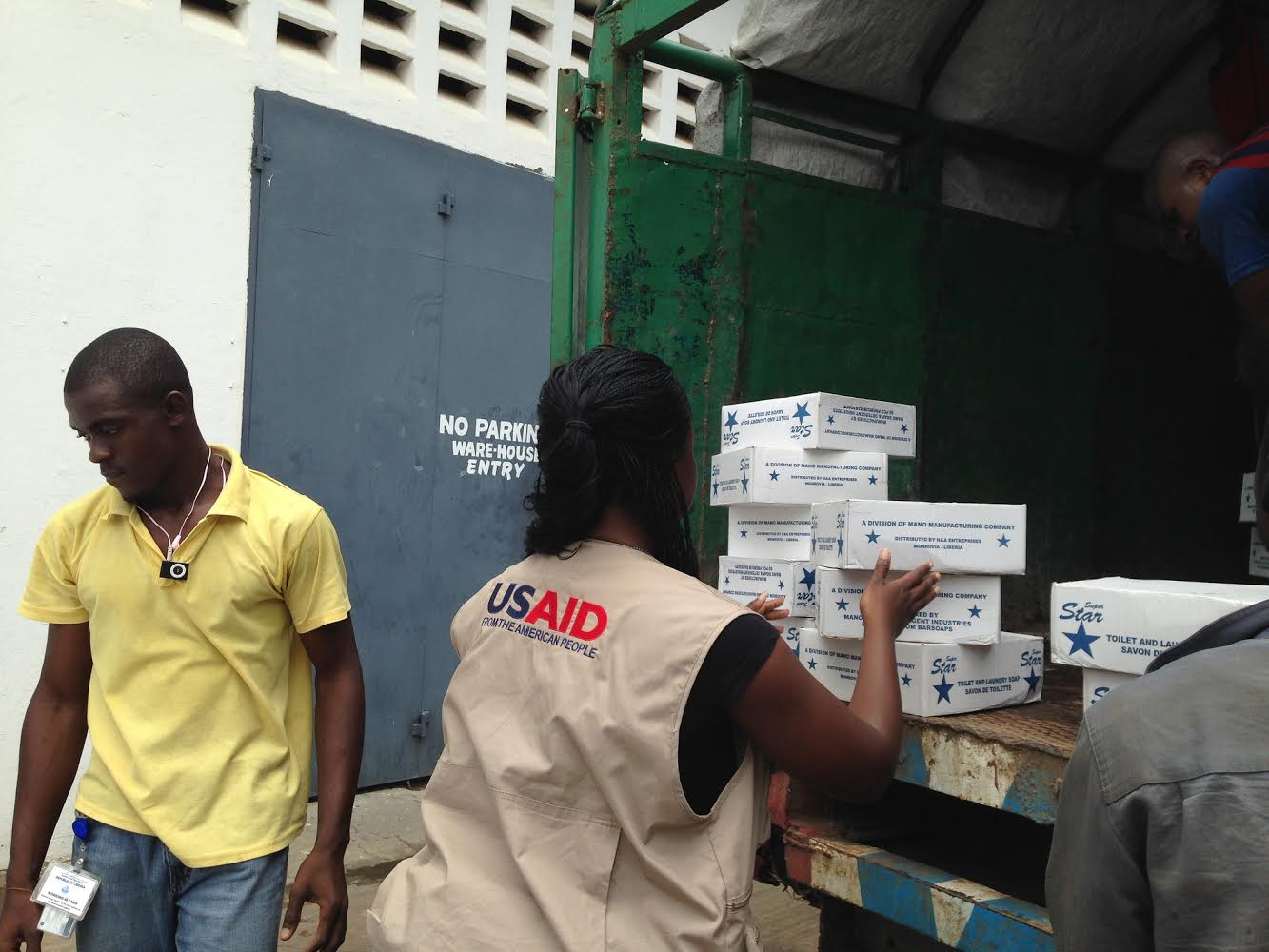 Members of the USAID-led Disaster Assistance Response Team (DART) procure and unload urgent Ebola relief supplies and hygiene items in Monrovia, Liberia, on Aug. 27, 2014.