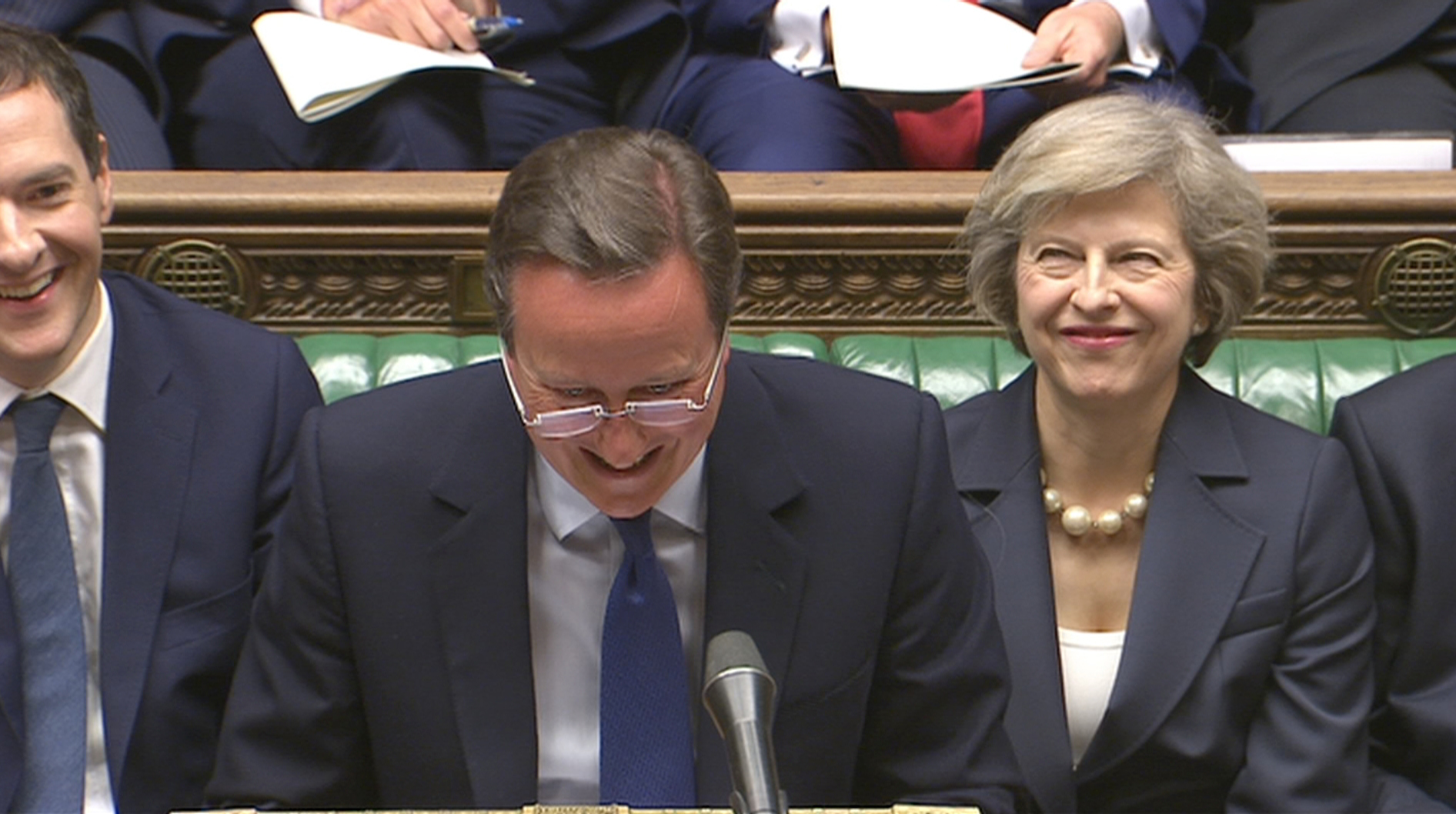 Britain's outgoing Prime Minister, David Cameron (C), incoming prime minister Theresa May (R) and Chancellor of the Exchequer George Osborne, laugh during Prime Minister's Questions in the House of Commons, in central London, Britain on July 13, 2016...