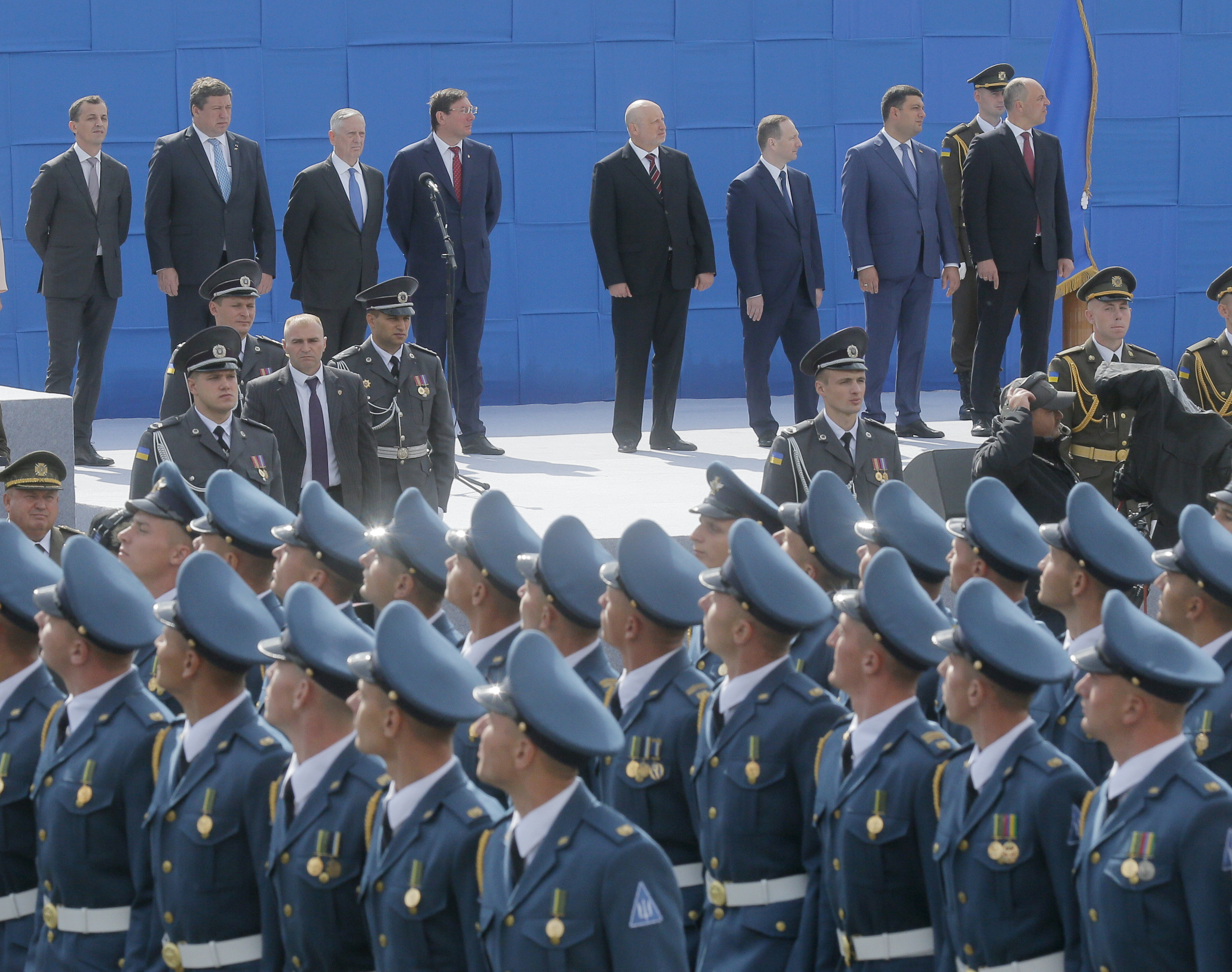 U.S. Defense Secretary James Mattis, third left, and Ukrainian officials watch a military parade to celebrate Independence Day in Kyiv, Ukraine, Aug. 24, 2017.