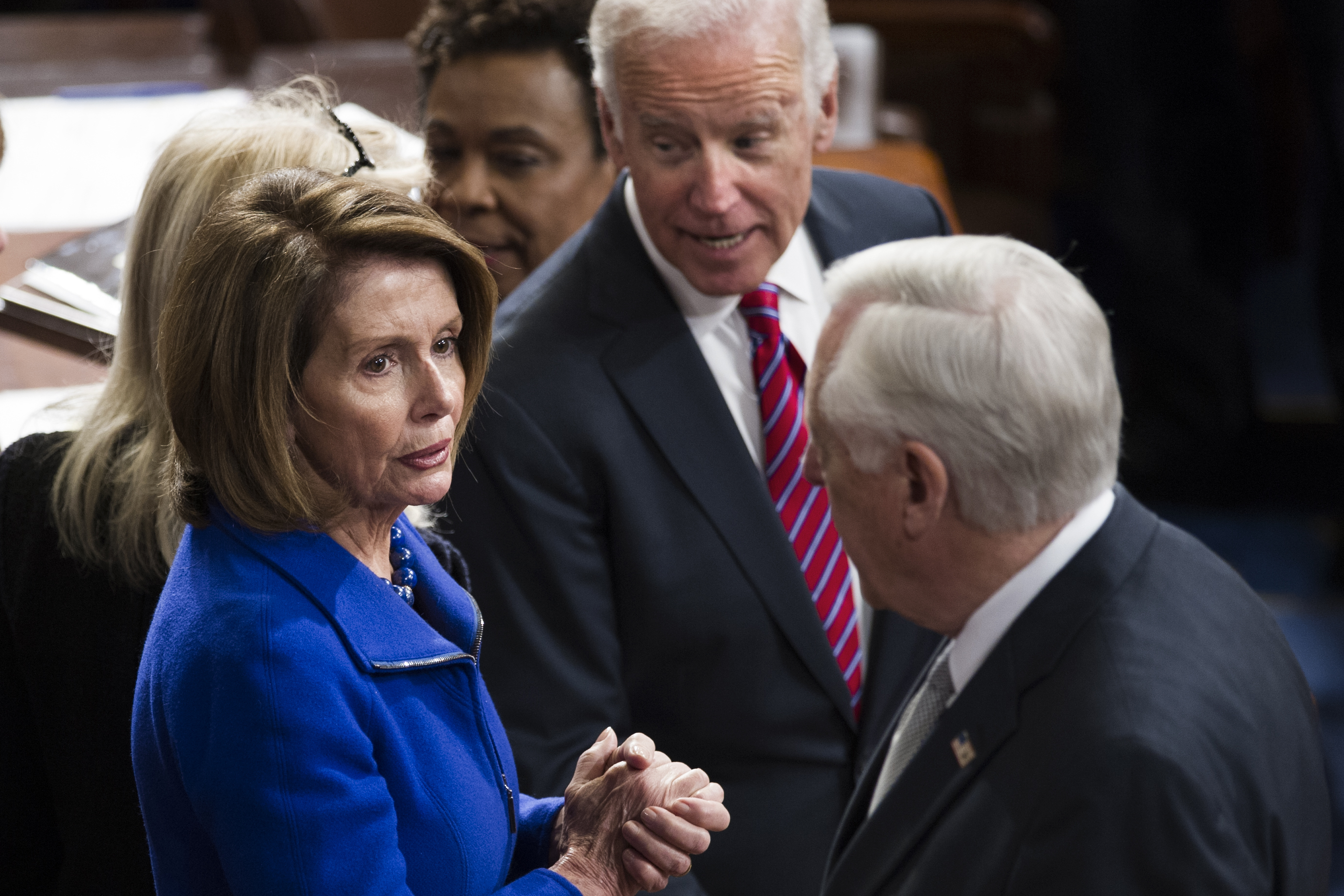 House Minority Leader Nancy Pelosi, center, Vice President Joe Biden, left, and Democratic Congressman Steny Hoyer talk after a joint session of Congress on Capitol Hill in Washington, Jan. 6, 2017.