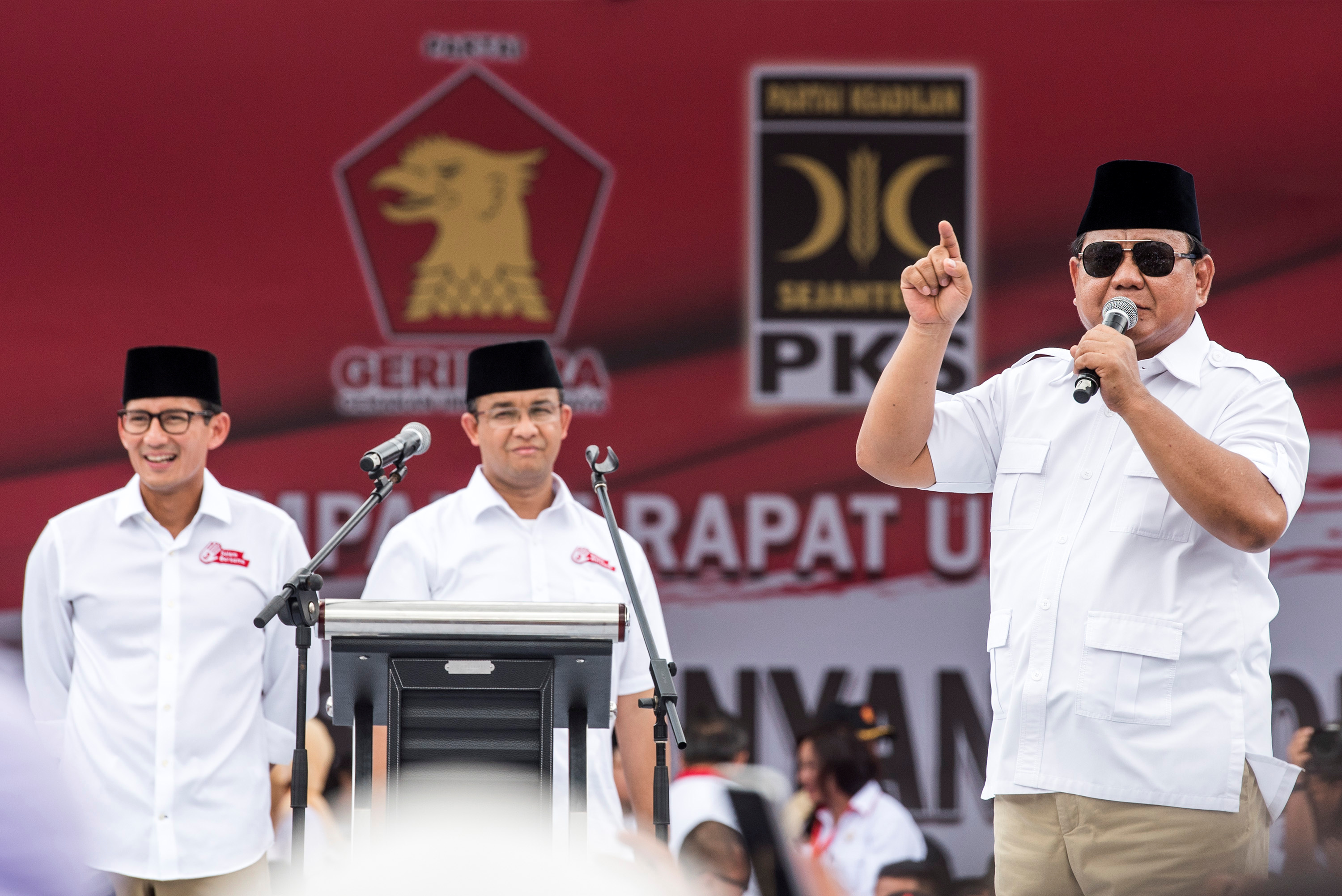 FILE - Gerindra party chairman Prabowo Subianto (R) talks to supporters.