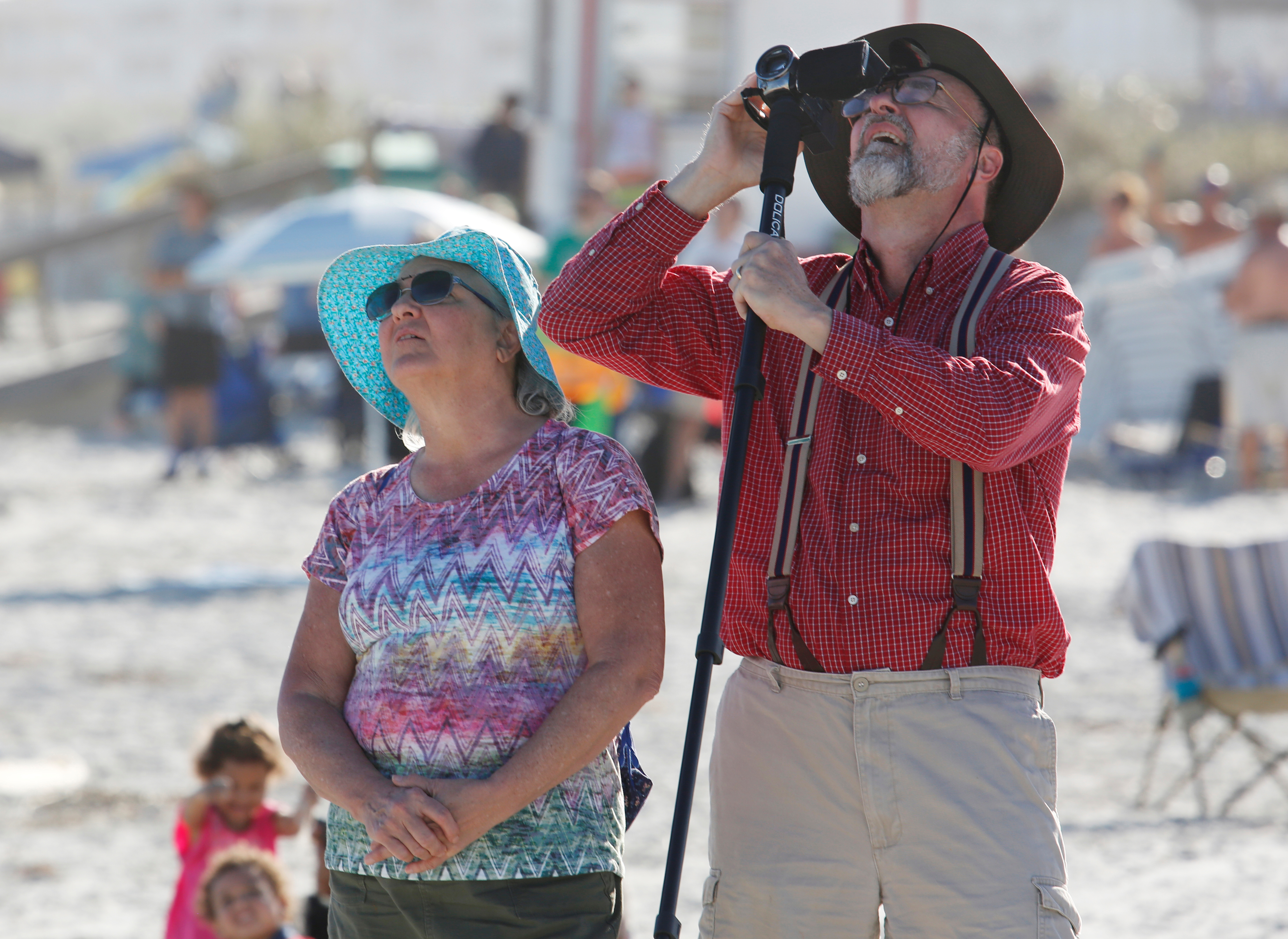 Spectators at Cocoa Beach watch SpaceX's first Falcon Heavy rocket launch from the Kennedy Space Center, Florida, Feb. 6, 2018.