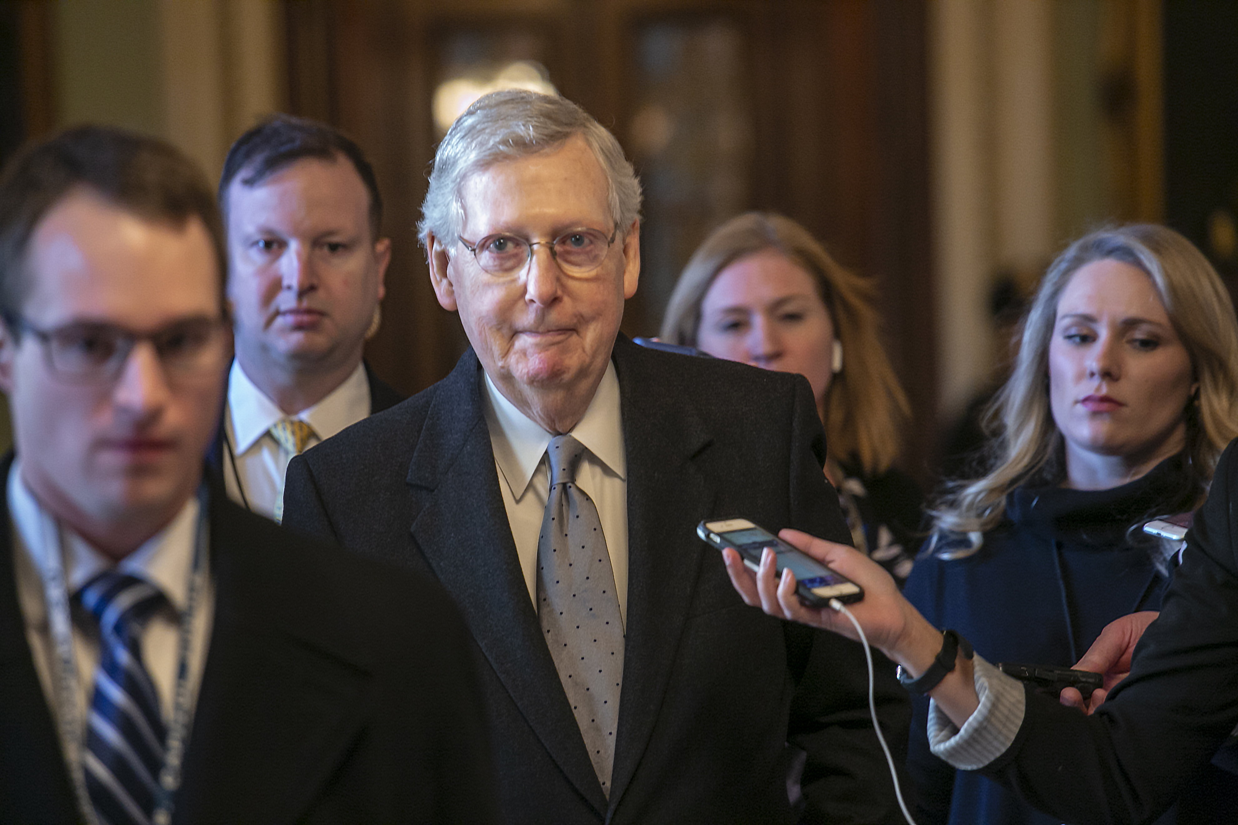 Senate Majority Leader Mitch McConnell, R-Ky., leaves the chamber after speaking about his plan to move a 1,300-page spending measure, which includes $5.7 billion to fund President Donald Trump's proposed wall along the U.S.-Mexico border, Jan. 22, 2