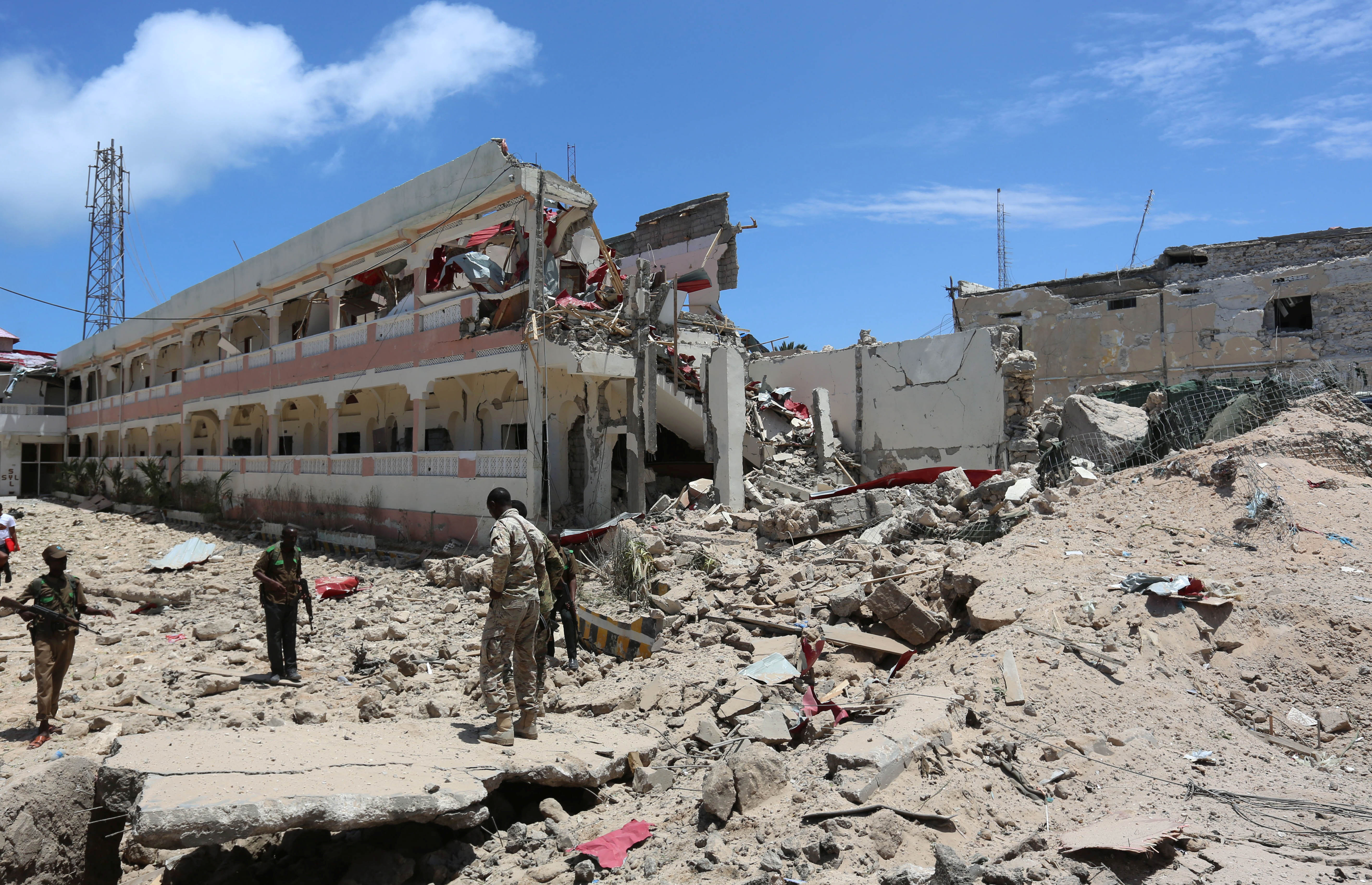 Security forces stand at the SYL hotel that was partly destroyed following a car bomb claimed by al Shabaab Islamist militants outside the president's palace in the Somali capital of Mogadishu, August 30, 2016.