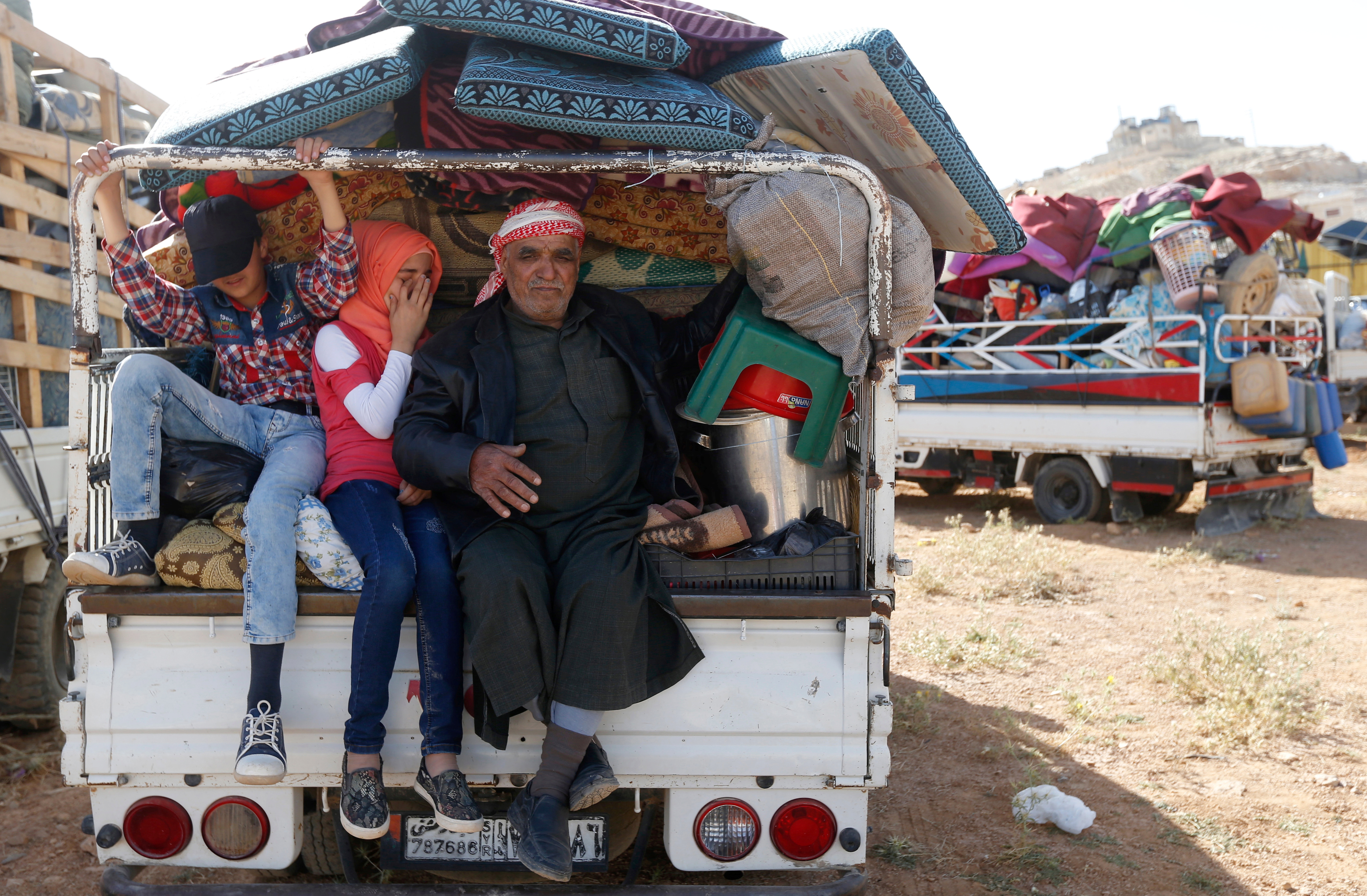 Syrian refugees prepare to return to Syria from the Lebanese border town of Arsal, Lebanon, June 28, 2018.