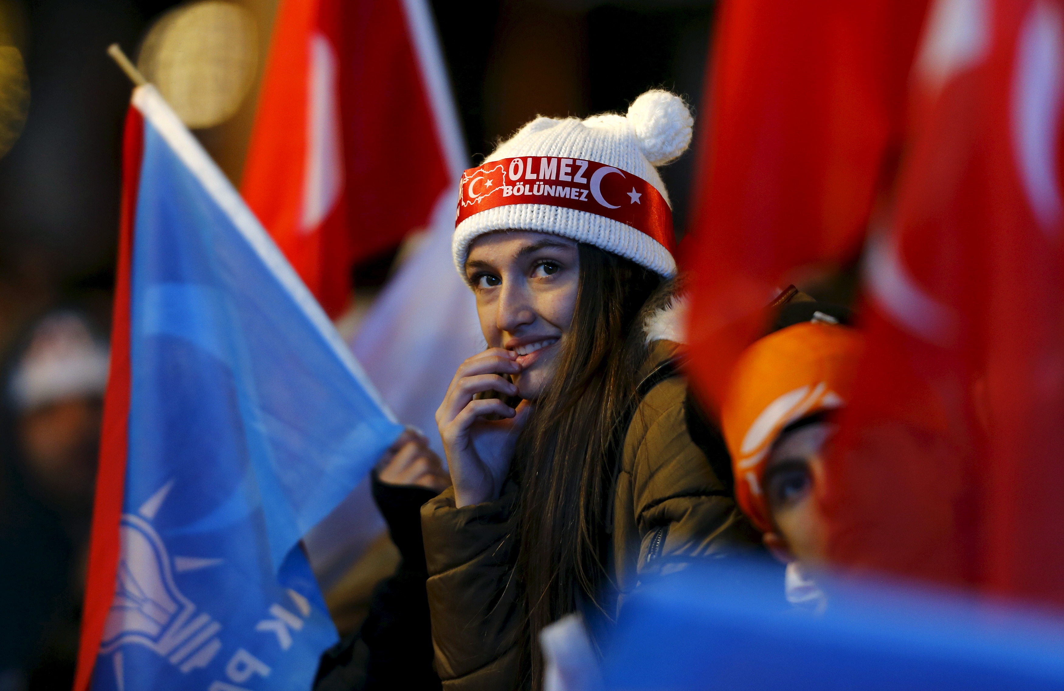 An AK Party supporter waits for the start of Turkey's Prime Minister Ahmet Davutoglu's speech in front of the party headquarters in Ankara, Turkey November 2, 2015.