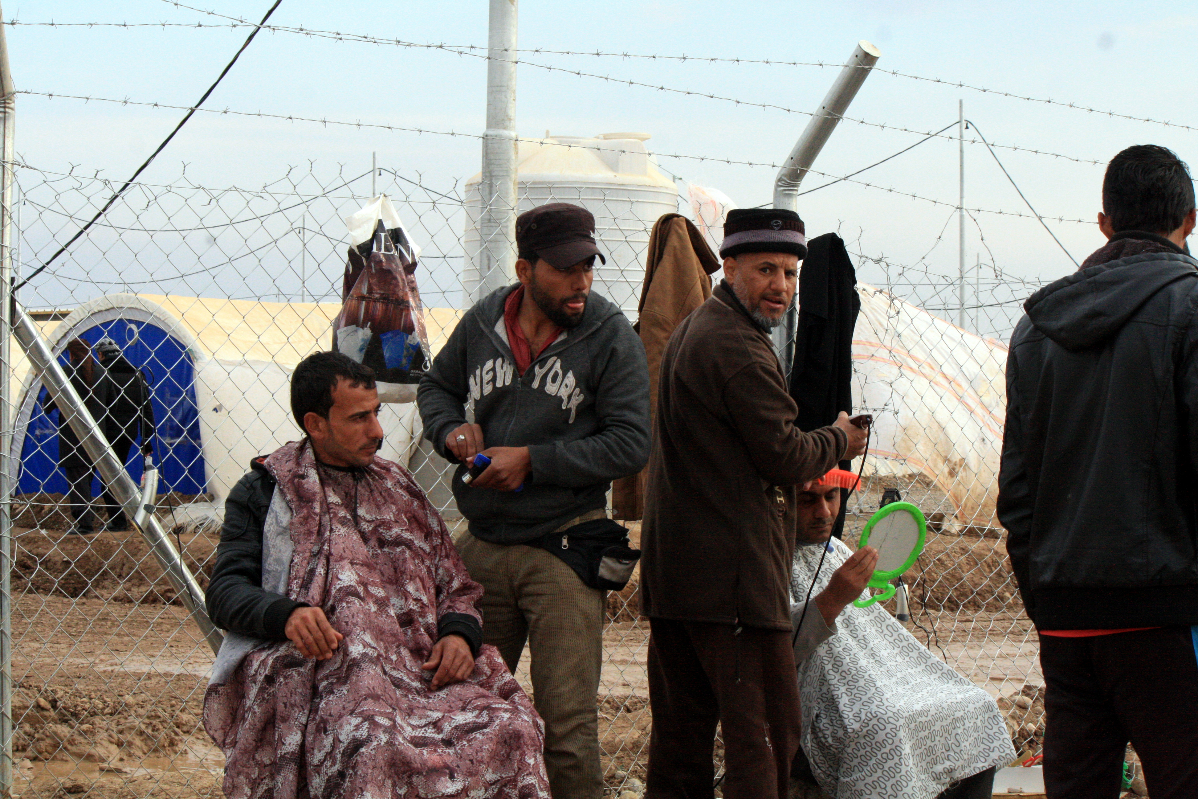 Makeshift barbershops dot the many camps in the region surrounding Mosul. Refugees say most people shave their IS-style beards and change their hairstyles as soon as possible after they escape, at the Khazir camp in Kurdish Iraq, Dec. 13, 2016. (H. M...
