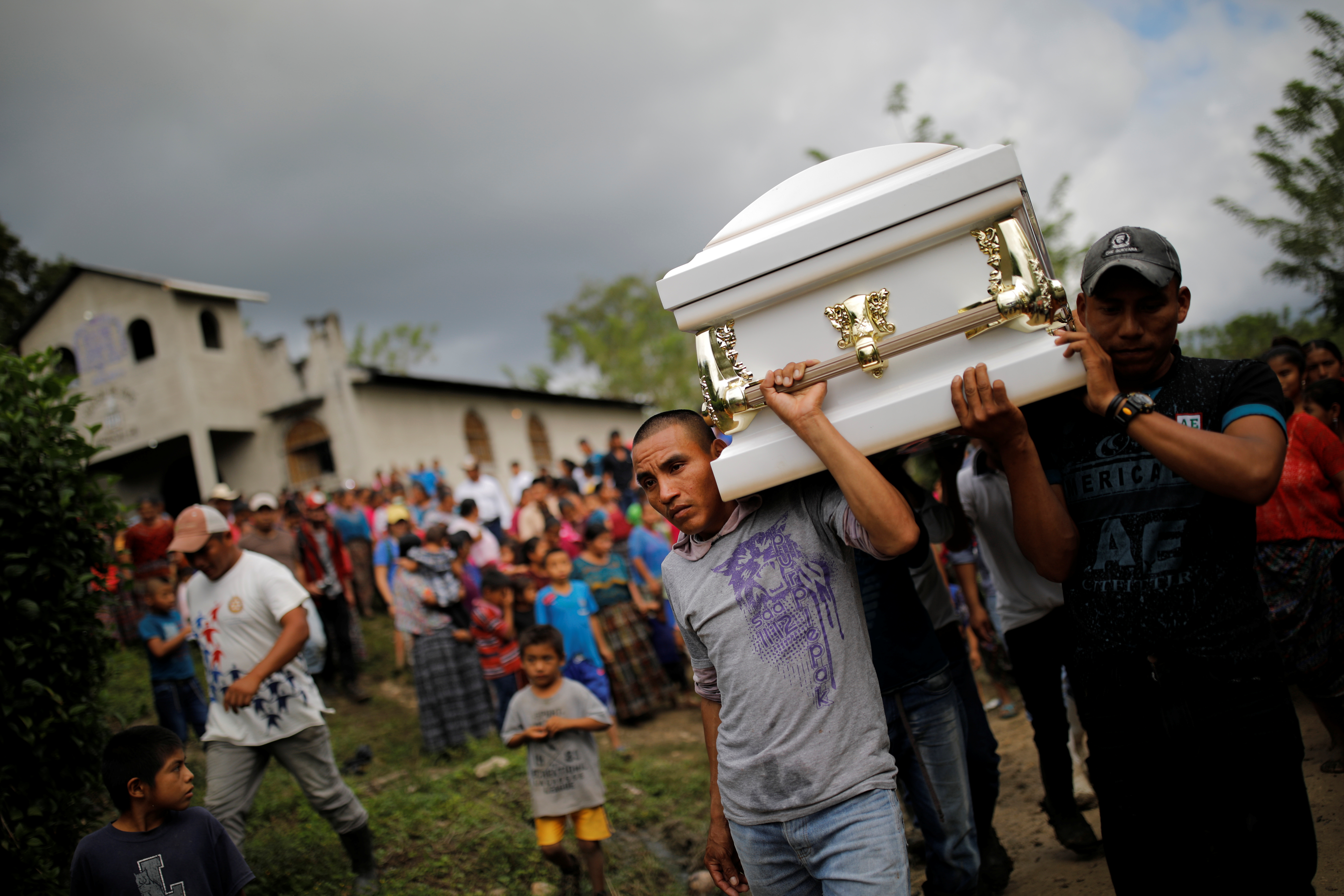 Friends and family carry a coffin with the remains of Jakelin Caal, 7, who died while in the custody of U.S. Customs and Border Protection, during her funeral at her home village of San Antonio Secortez, in Guatemala, Dec. 25, 2018.