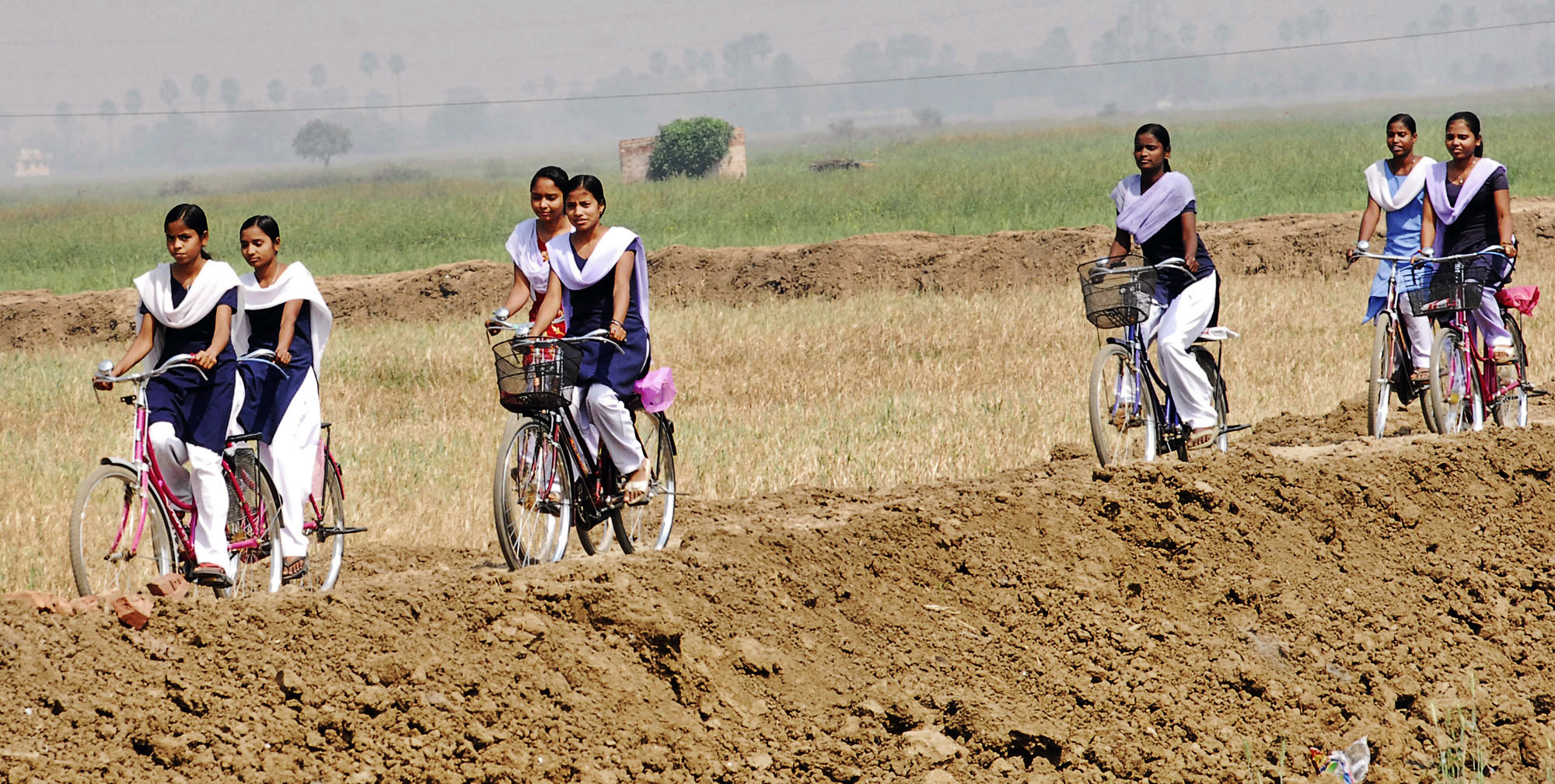 Indian schoolgirls ride bicycles, received under a Bihar government program of giving bicycles to teenage girls to keep them in school.