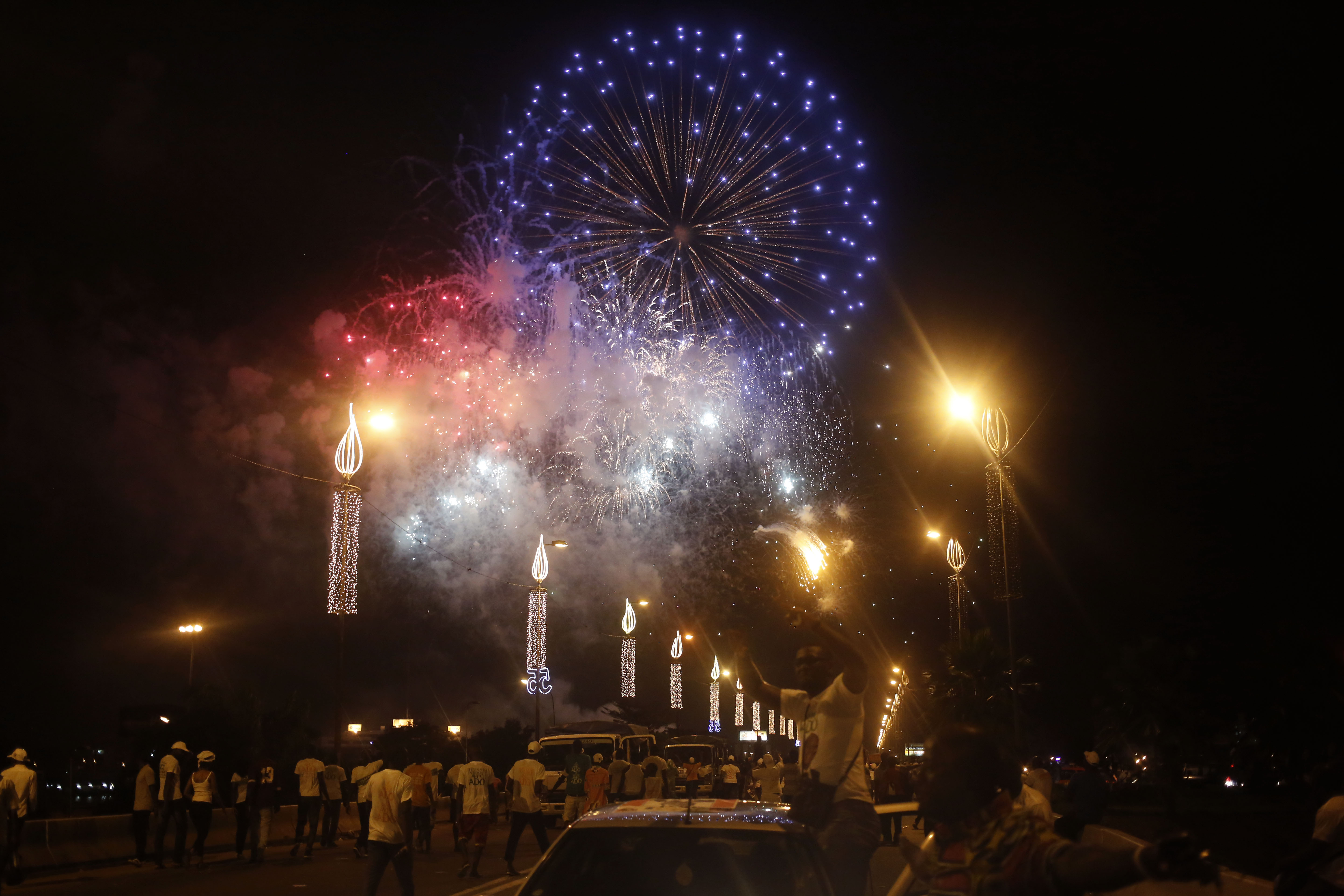 Fireworks explode during an election rally by Ivory Coast incumbent President Alassane Ouattara in Abidjan, Oct. 23, 2015.