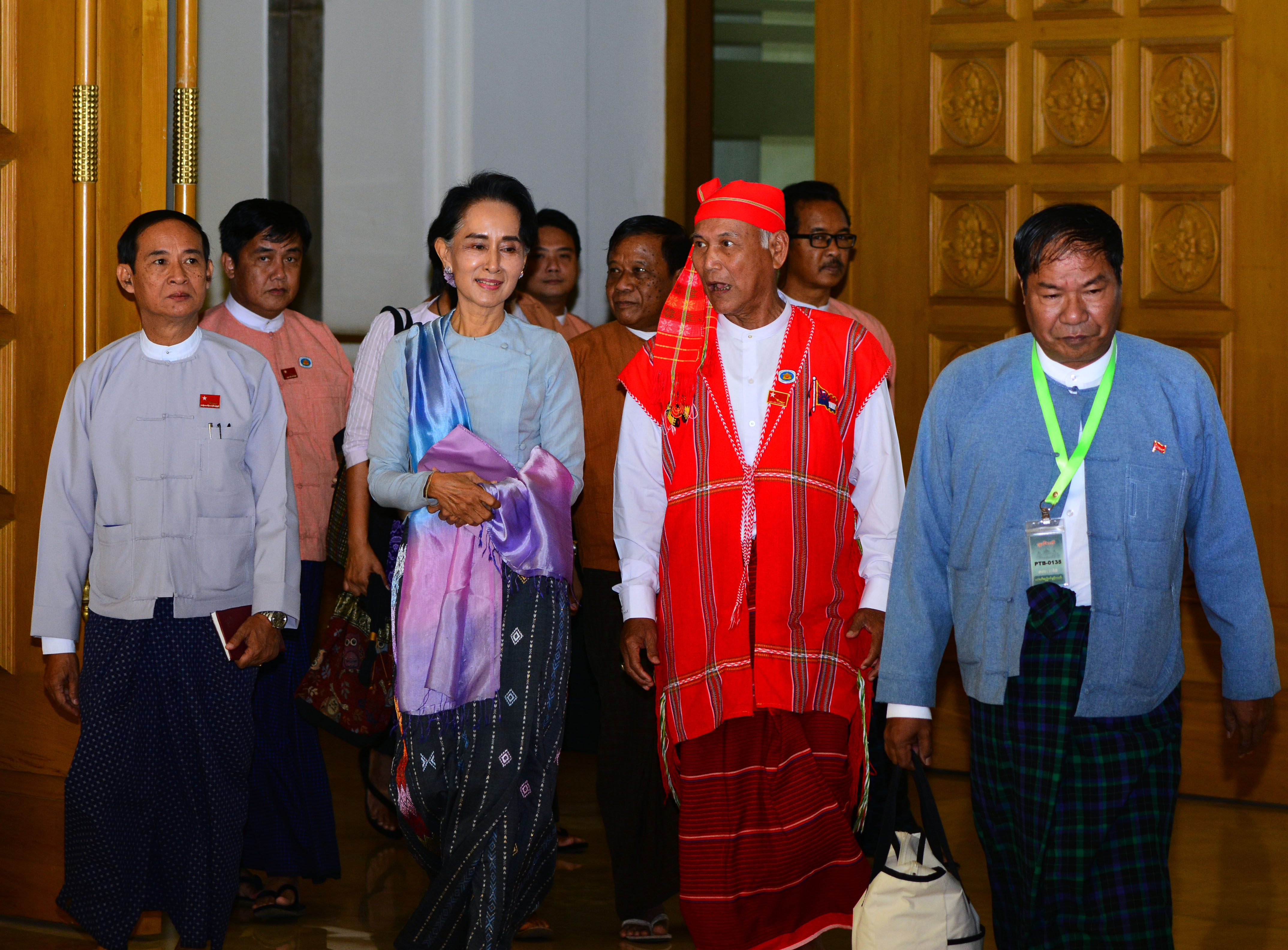 Myanmar opposition leader Aung San Suu Kyi, second from left, walks with members of her National League for Democracy party upon their arrival to attend regular session of the parliament's Lower House in Naypyitaw, Myanmar, Dec 1, 2015.