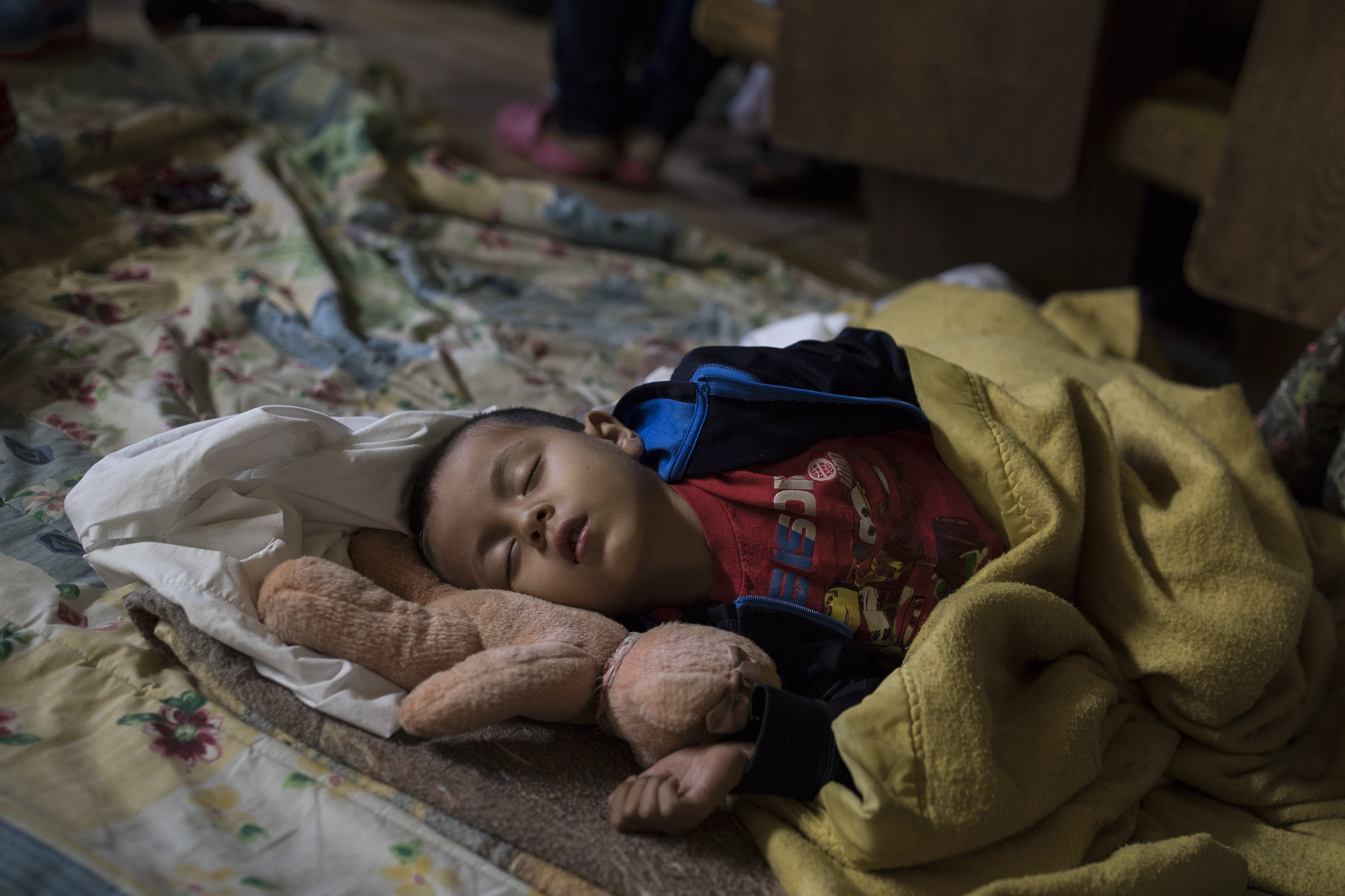 A Central American child who is traveling with a caravan of migrants sleeps at a shelter in Tijuana, Mexico,  April 29, 2018.