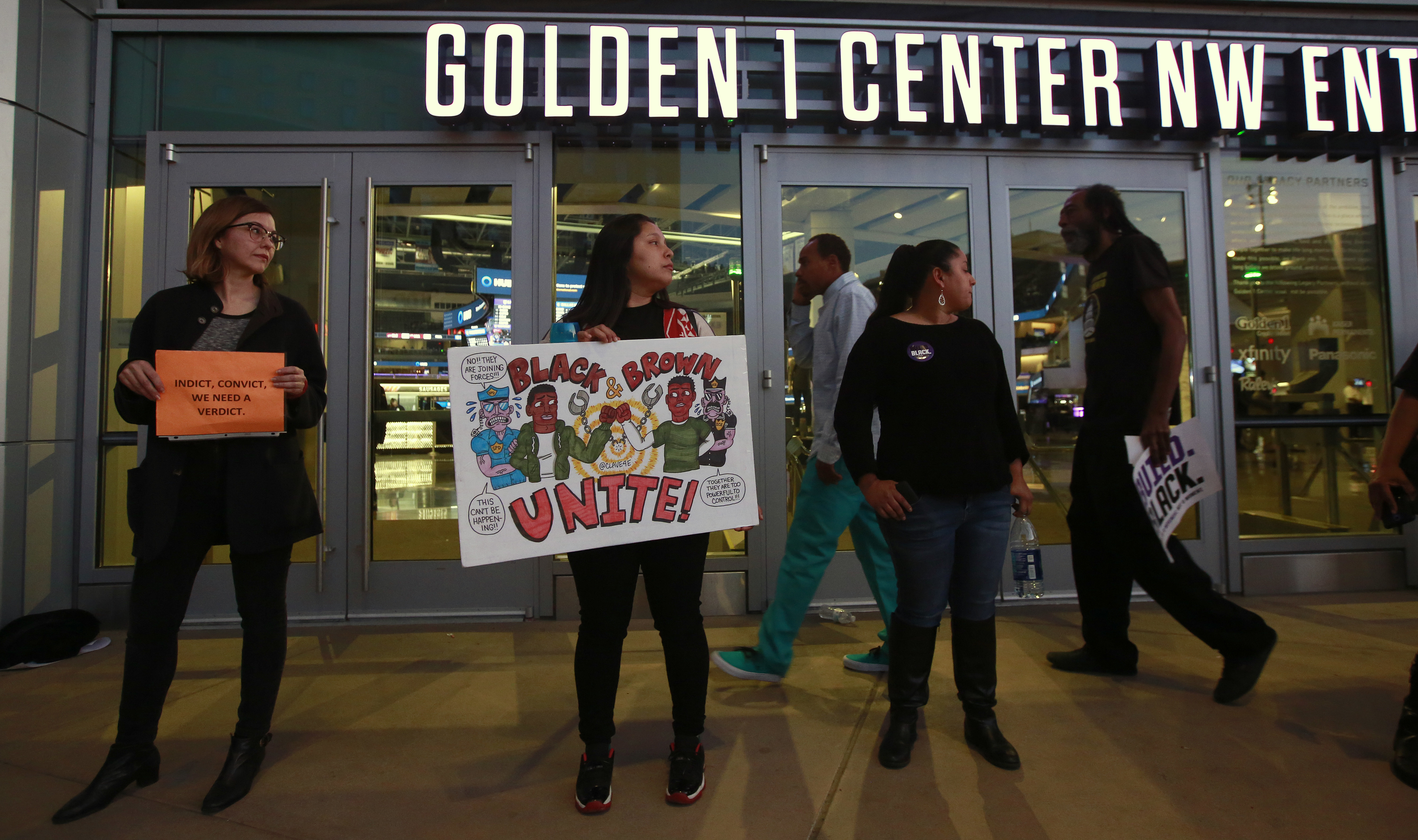 Demonstrators protesting the shooting death of Stephon Clark by Sacramento Police officers on March 18, block the entrance to the Golden 1 Center, preventing ticket holders from entering to watch the Dallas Mavericks play the Sacramento Kings in an N...