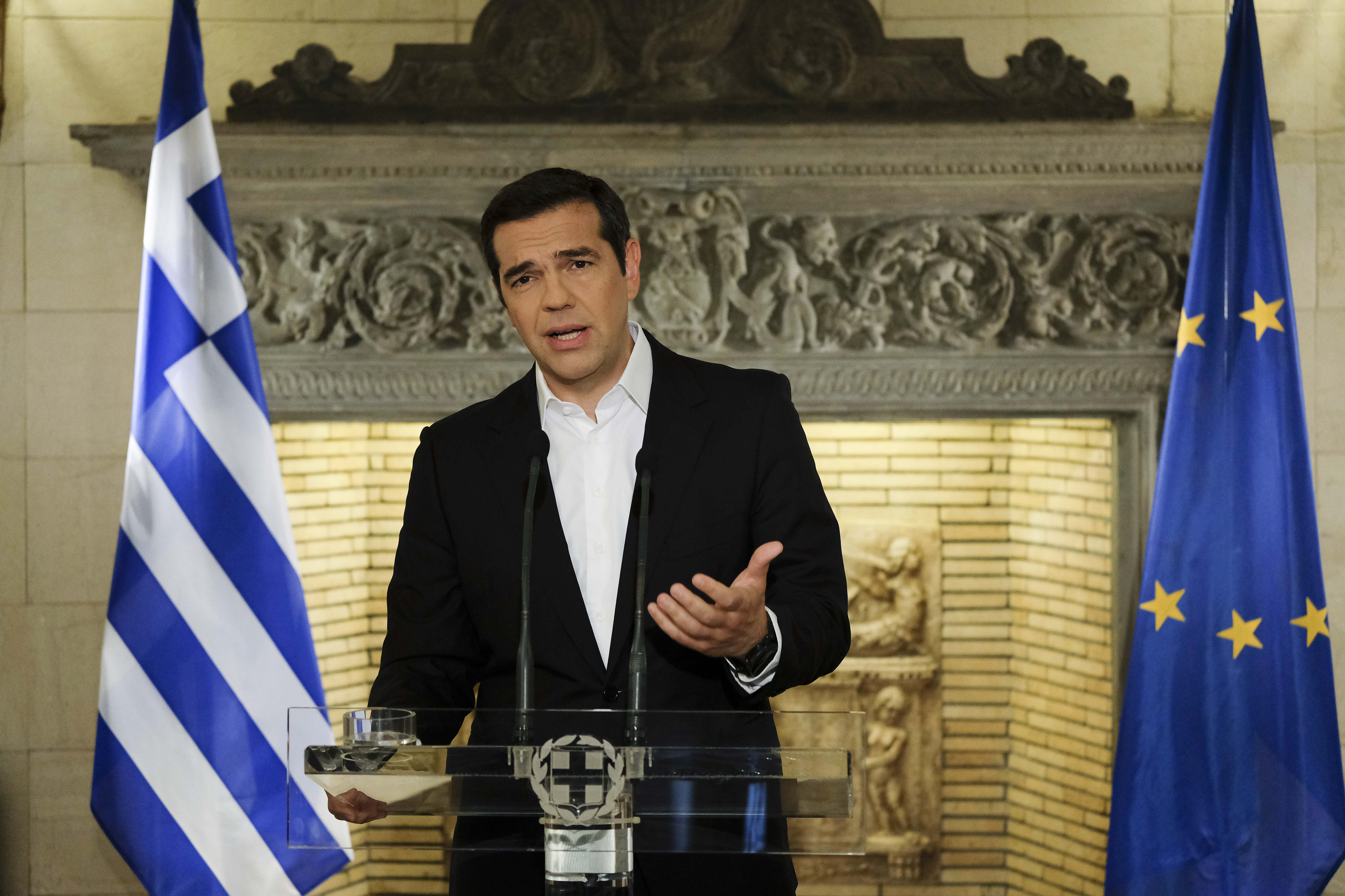 In this photo released by Greek Prime Minister's office, Greek Prime Minister Alexis Tsipras speaks during a televised address to the nation, in Athens,  June 12, 2018.
