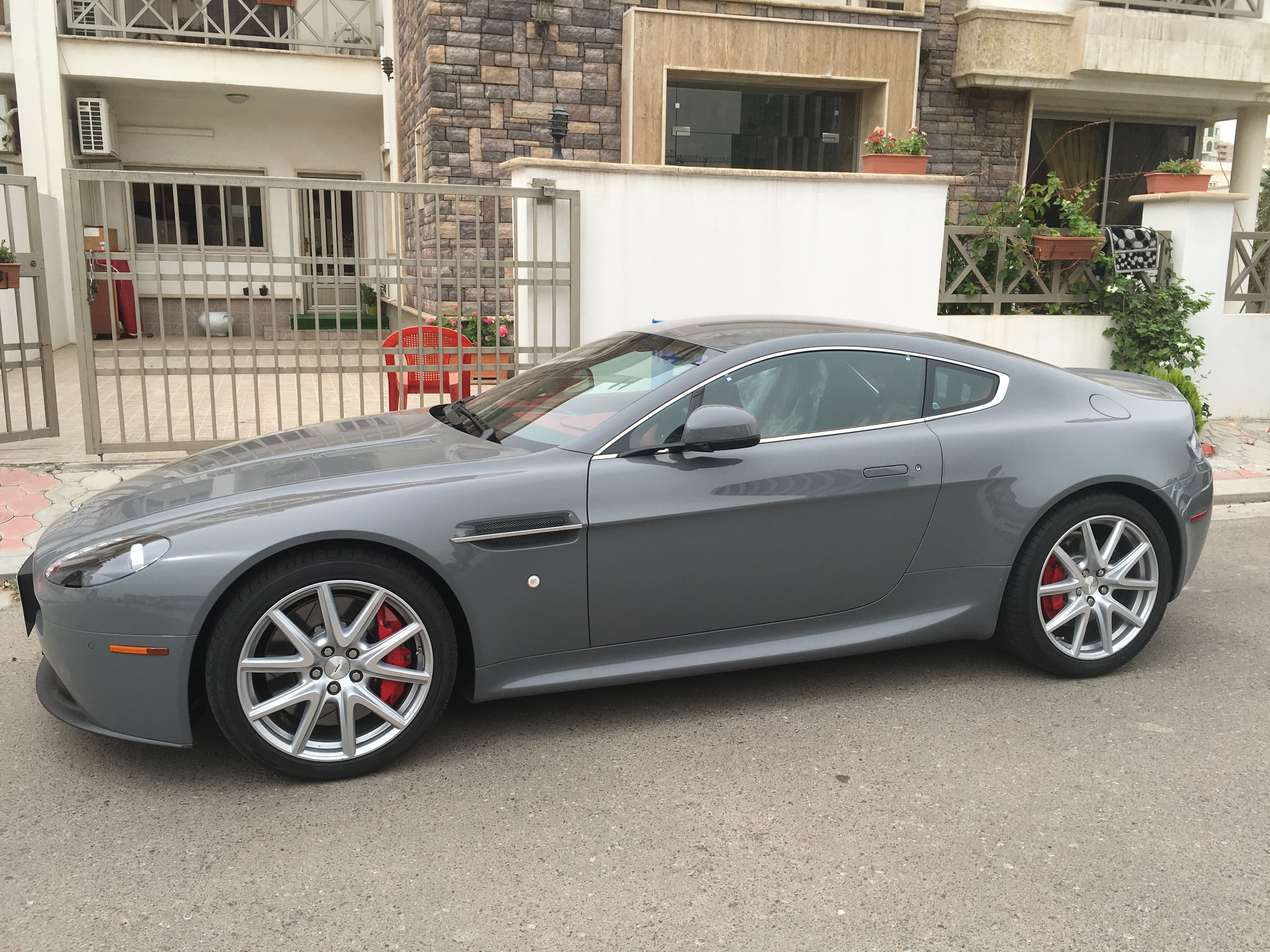 In a sign that some people in cash-strapped Iraqi Kurdistan still have means for the extravagant, a meticulously polished late-model Aston Martin is seen parked on a street in Irbil, the region's capital. (S. Behn/VOA)