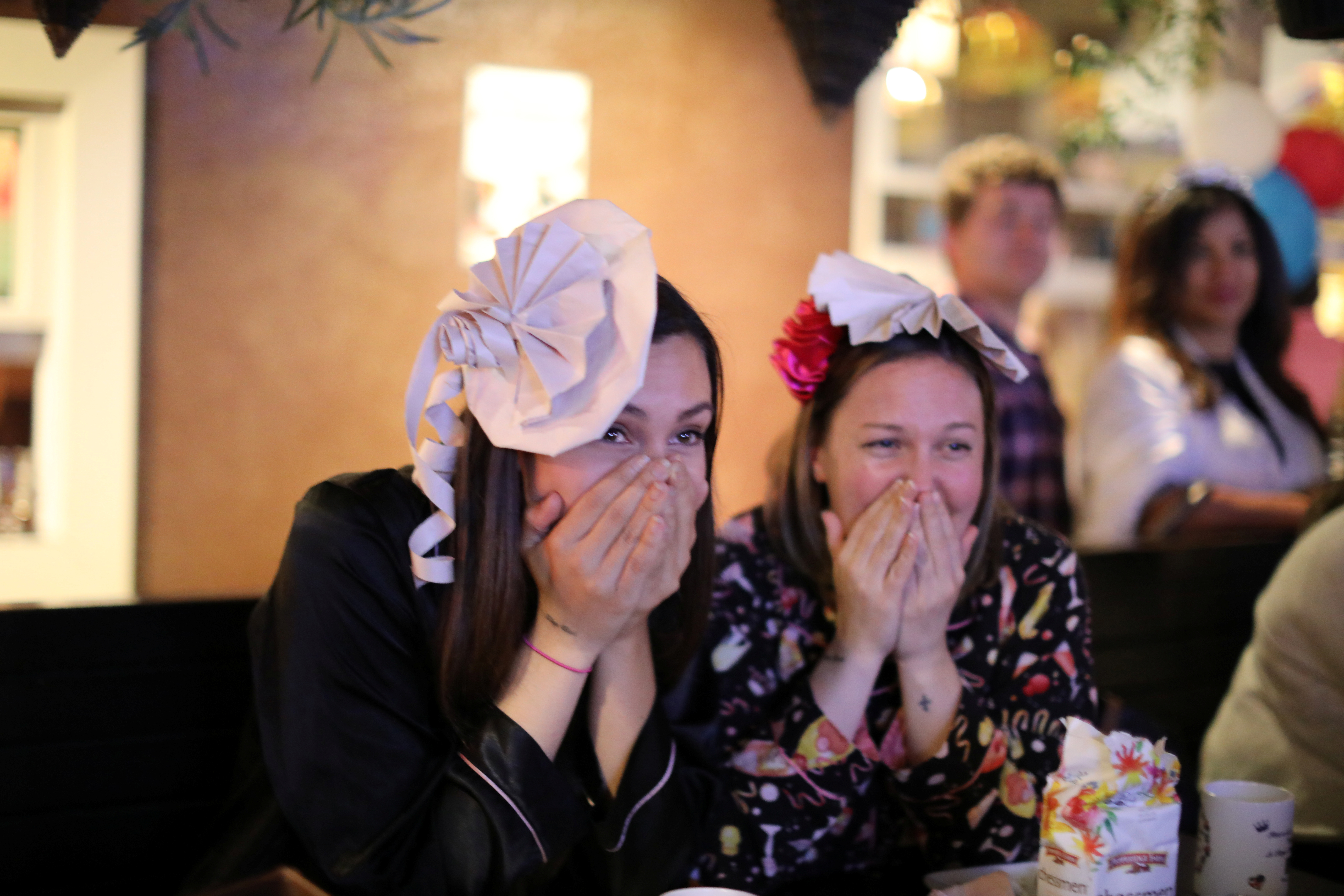 Women react during a royal wedding watching party for the wedding of Britain's Prince Harry and Meghan Markle at the Cat & Fiddle pub in Hollywood, Los Angeles, California, May 19, 2018.