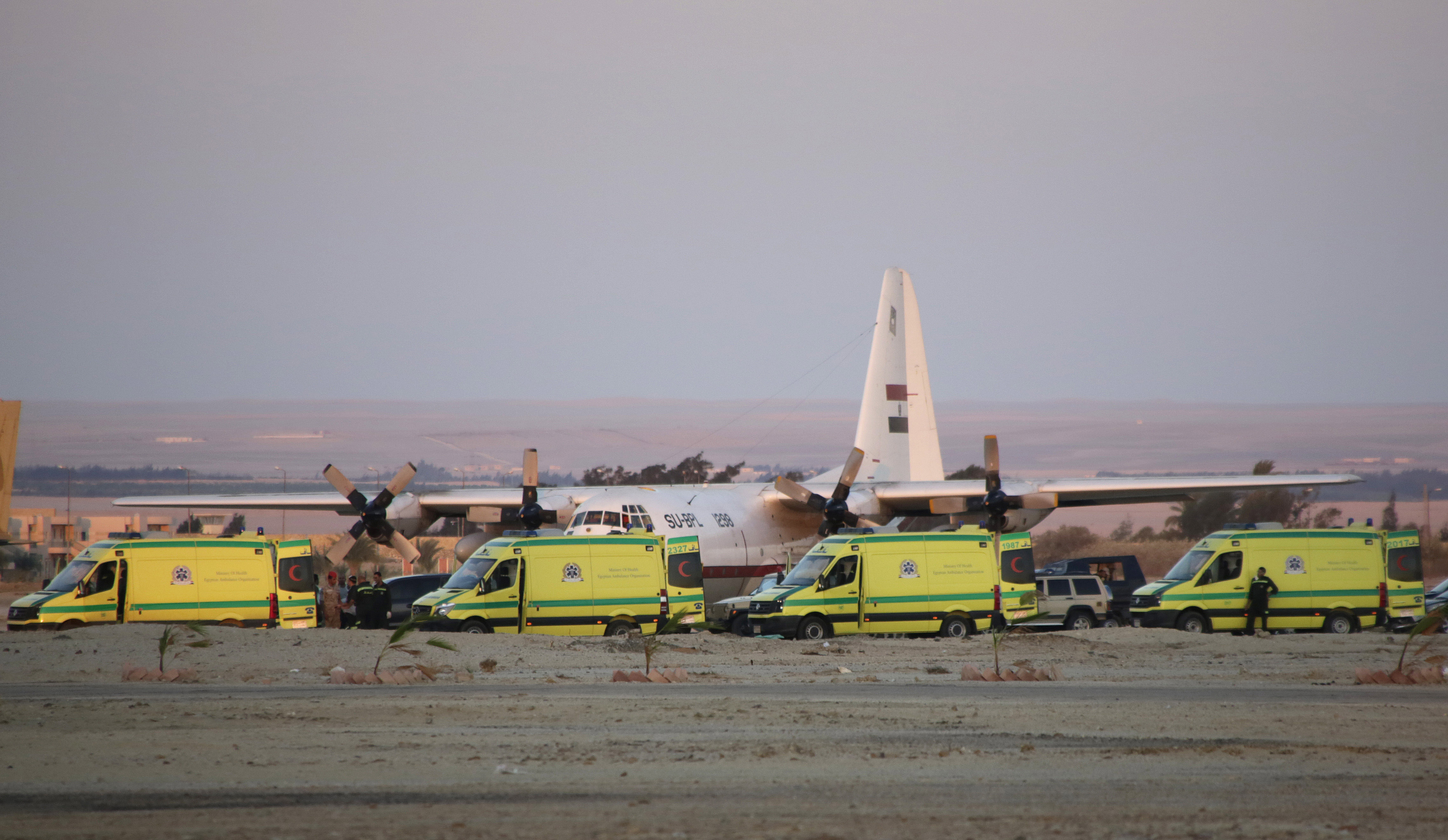 Ambulances line up as emergency workers unload bodies of victims from the crash of a Russian aircraft over the Sinai peninsula at the Kabrit military airport, some 20 miles north of Suez, Egypt, Oct. 31, 2015.