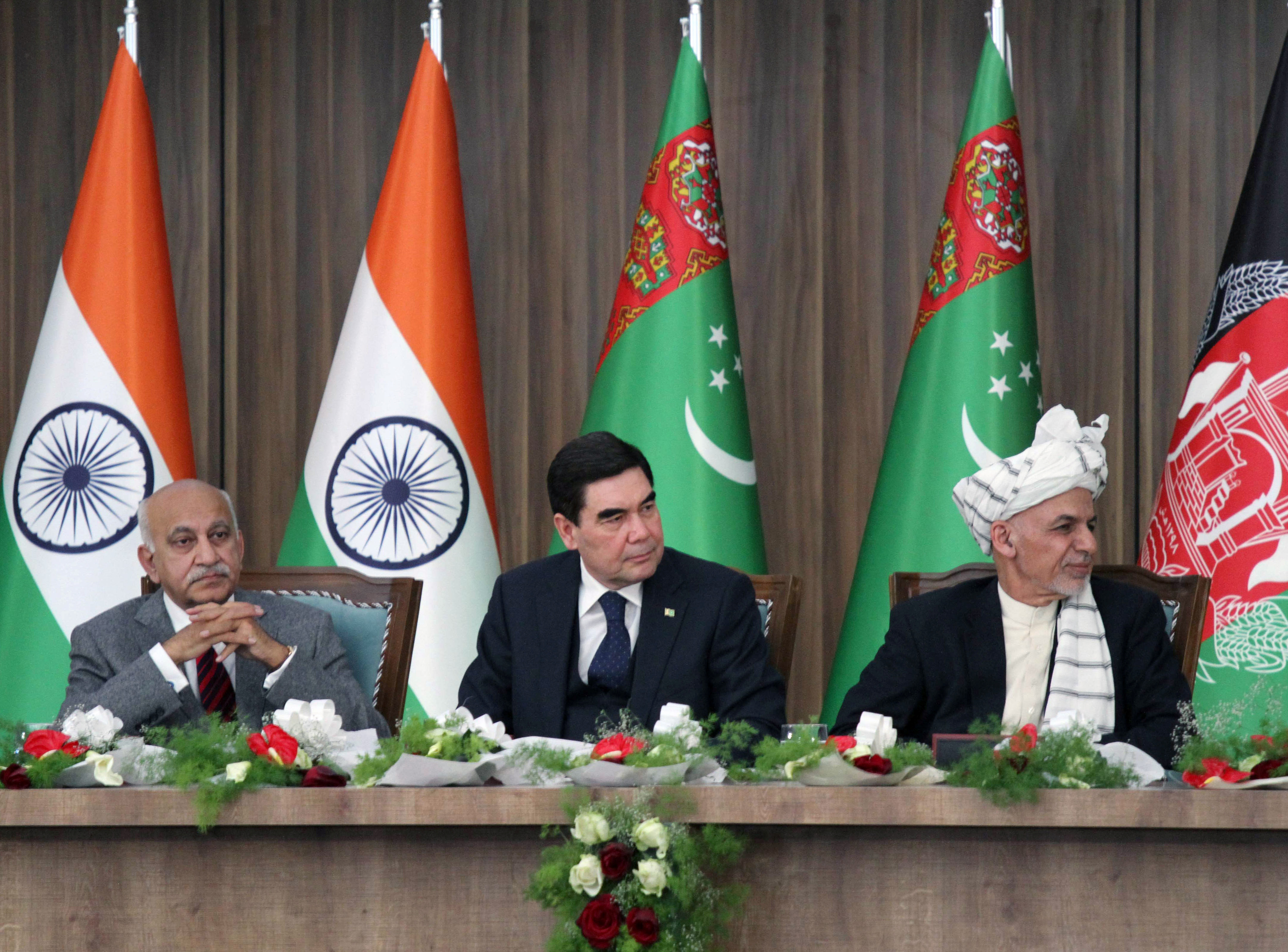 Afghanistan President Ashraf Ghani, right, Turkmenistan President Kurbanguly Berdymukhamedov, center, and India's Minister of State for External Affairs M.J. Akbar attend the inauguration ceremony of TAPI pipeline construction work, in Herat, Afghani...