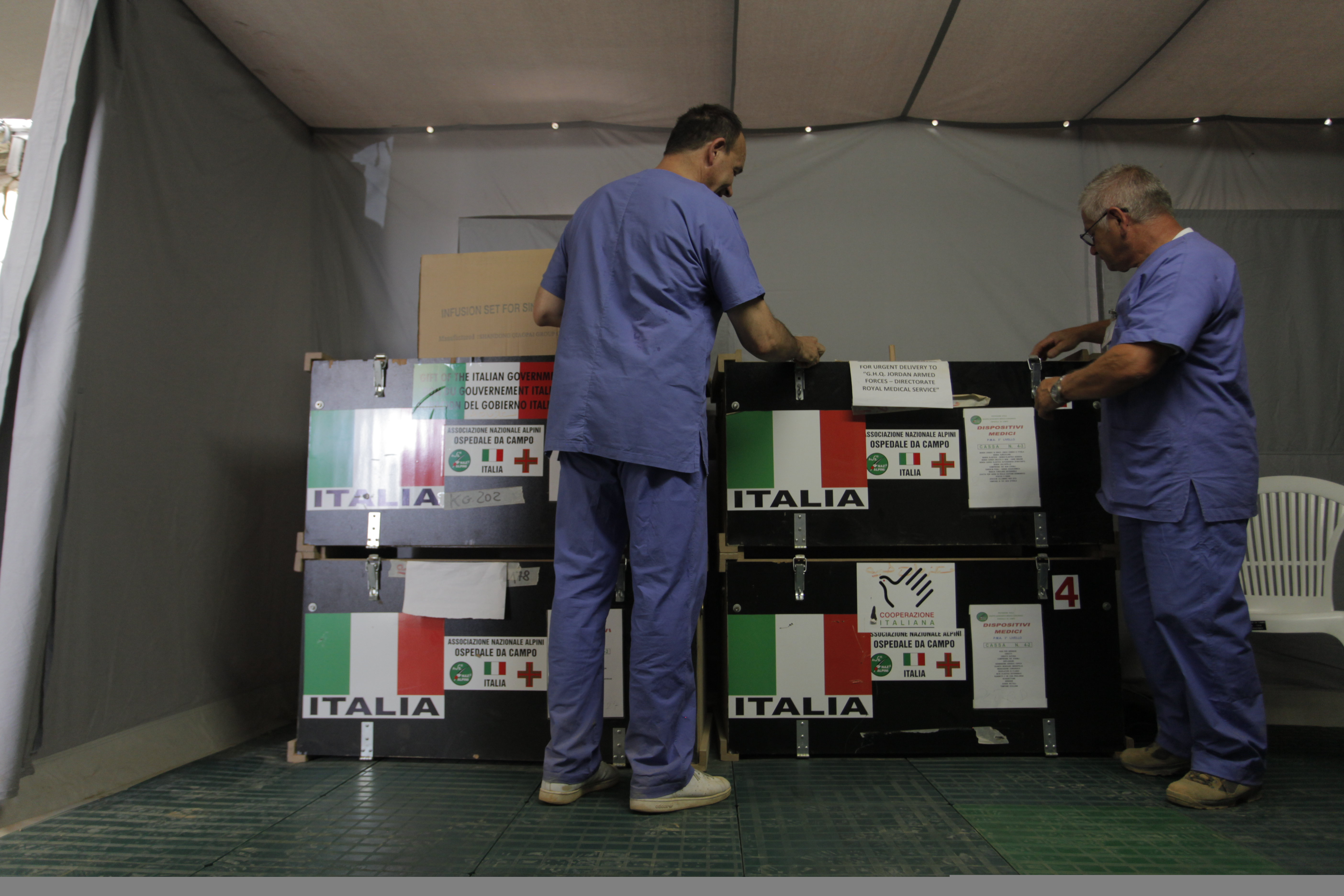 The Italian Medical crew opens the medical supplies boxes at the Italian Field Hospital for Syrian refugees, which was established in al Mafraq city, Jordan, July 10, 2012.