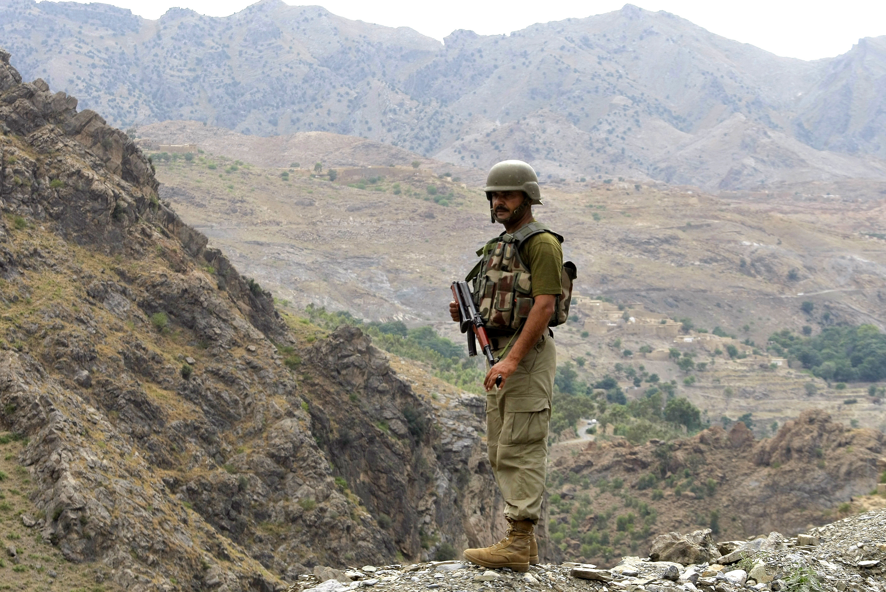 FILE - A Pakistan army soldier stands guard in the Pakistani tribal area of Khyber near the Torkham border post between Pakistan and Afghanistan, June 15, 2016.