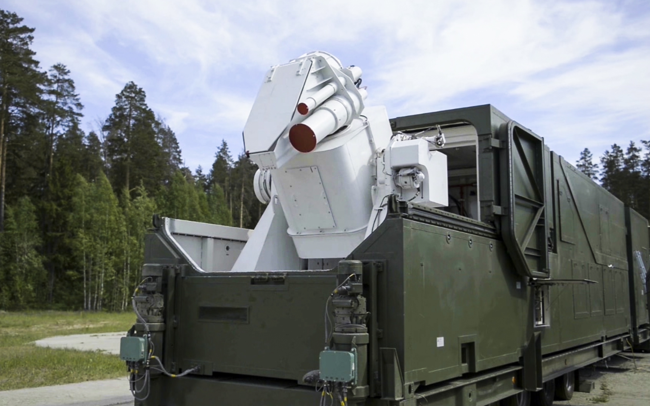 In this video grab provided by RU-RTR Russian television via AP television, March 1, 2018, a Russian military truck with a laser weapon mounted on it is shown at an undisclosed location in Russia. President Vladimir Putin declared Thursday that Russi...