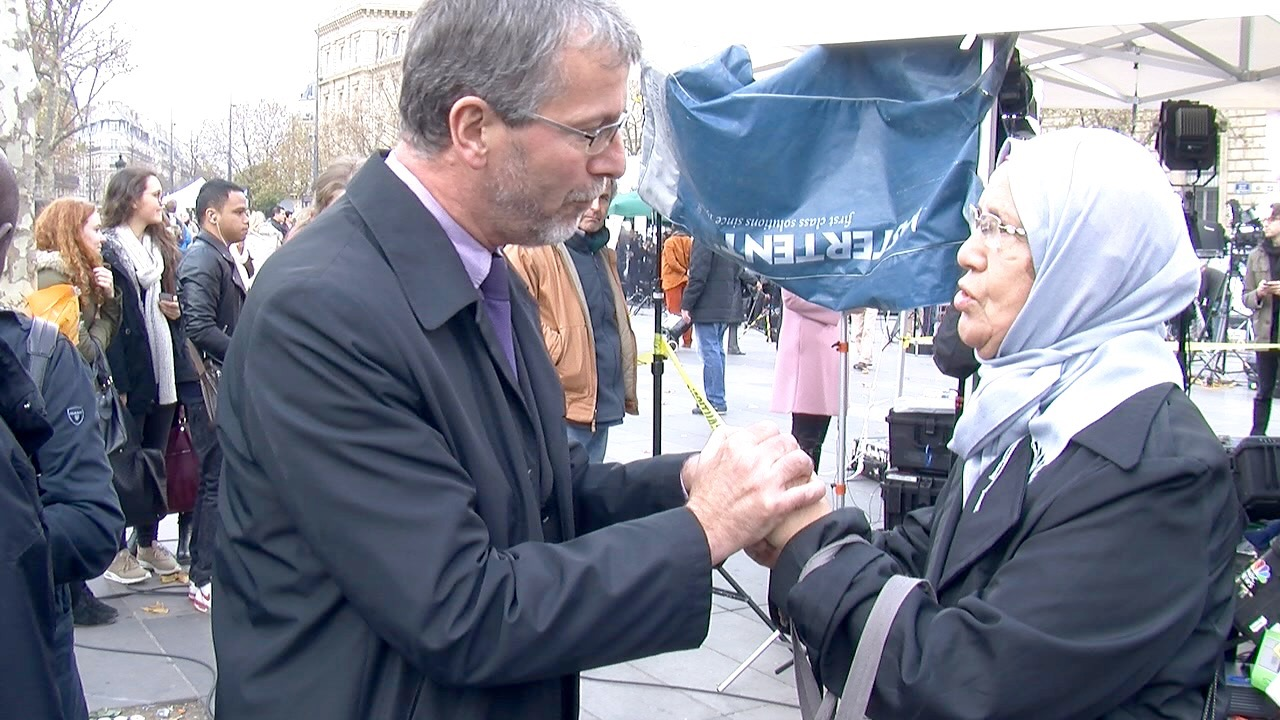 """Joining the crowds at Place de la Republique on Monday, Fatiha, a 70-year-old Algerian woman, said, """"I'm incensed when people mix us up with those extremists. """" A man took her hand and said, """"Not all French do that, madame. Today, we're all..."""