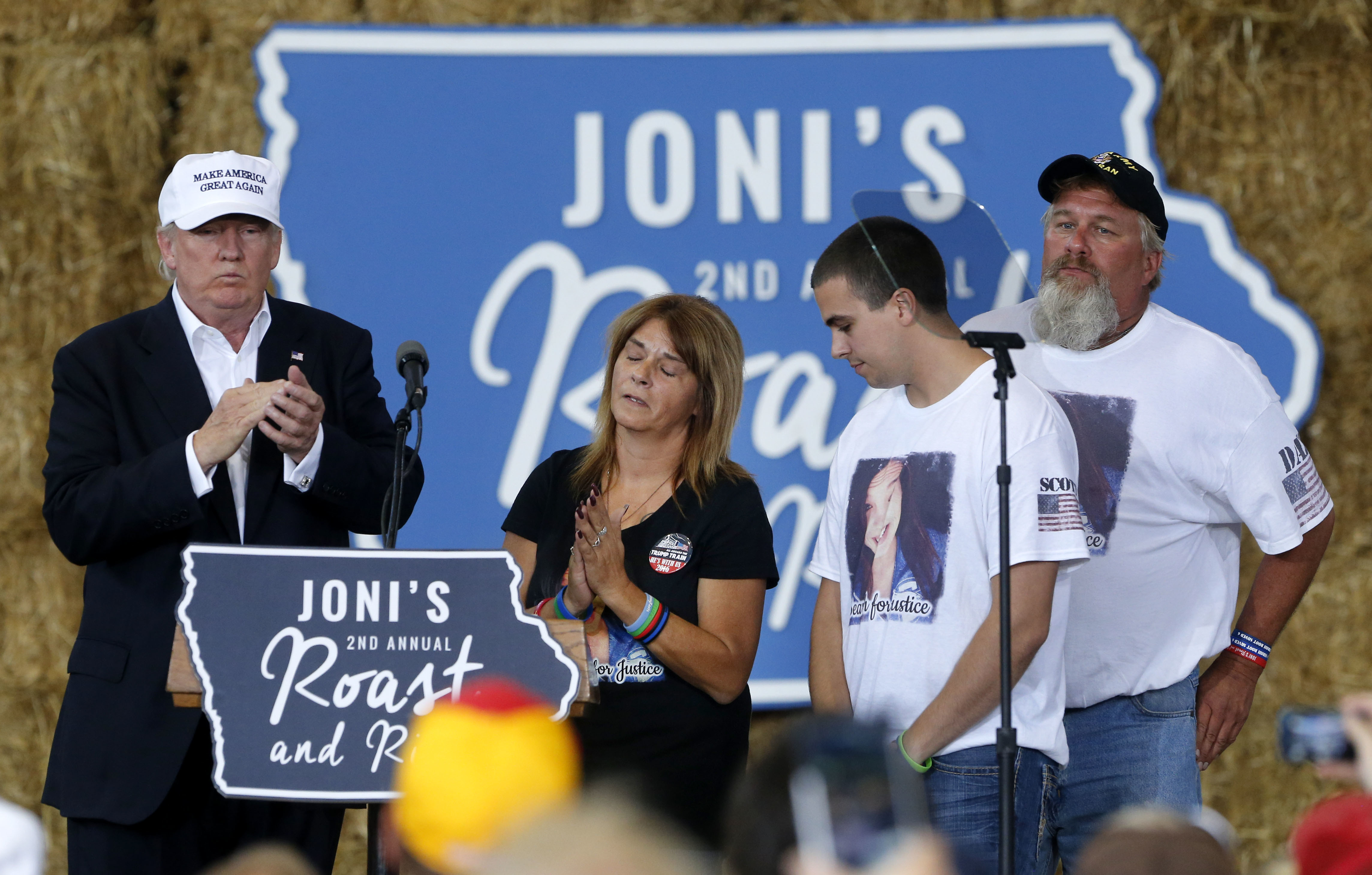 Republican presidential candidate Donald Trump shares the stage with the family of Sarah Root at a campaign event at the Iowa State Fairgrounds in Des Moines, Aug. 27, 2016. Root was killed this year after her car was hit by another. The driver, who ...