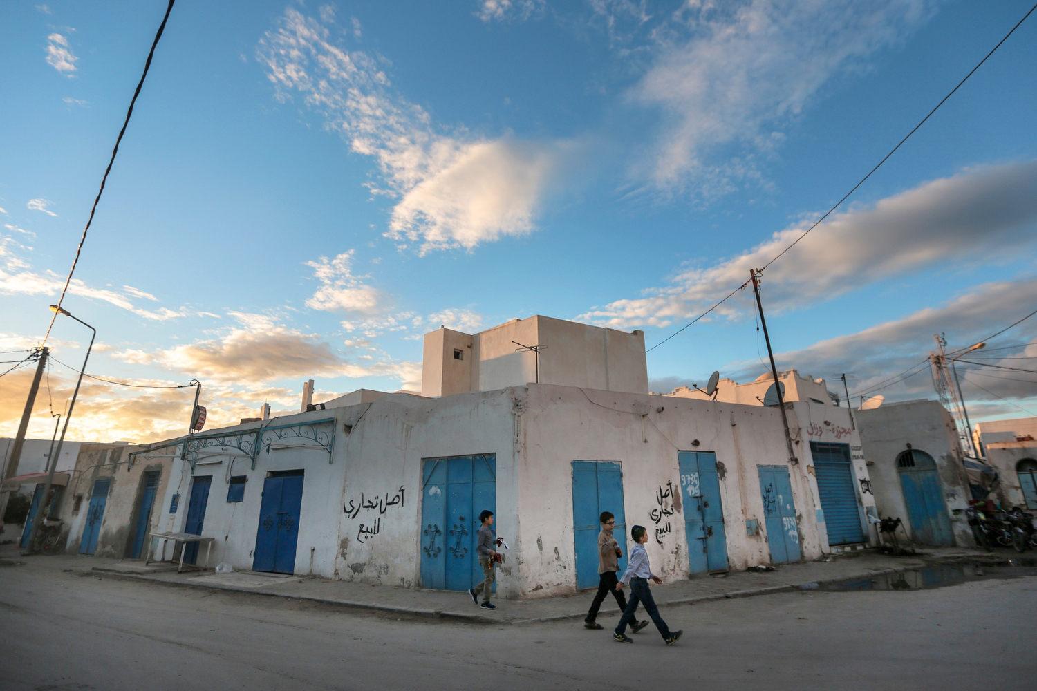 Boys walk past closed shops on the beginning of Shabbath, after sunset, at Hara Kbira, the main Jewish neighborhood in the Island of Djerba, southern Tunisia, Oct. 30, 2015.