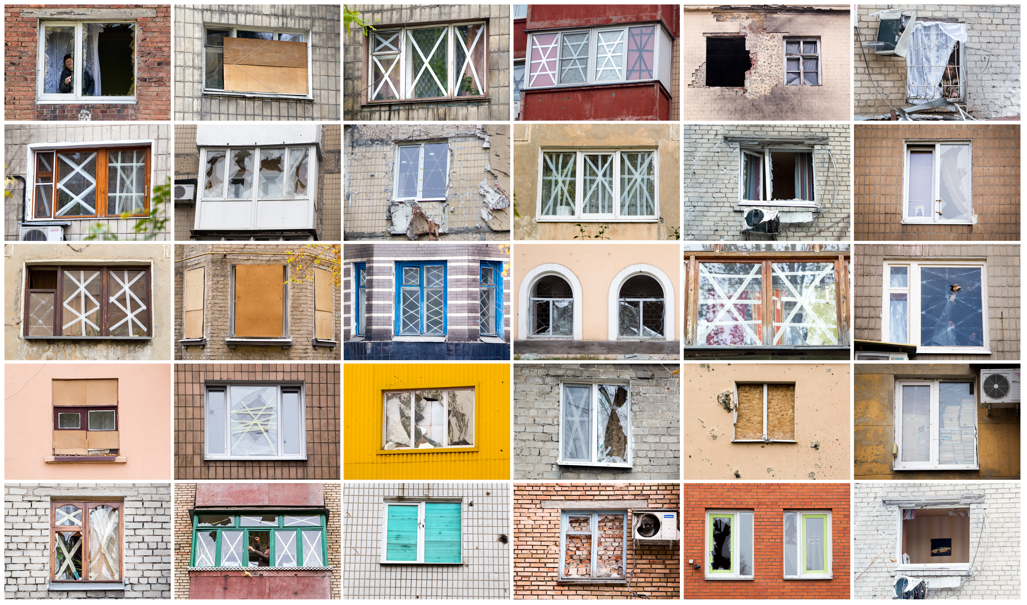 FILE - A combination photograph of windows of homes destroyed after shelling in Ukraine's Donbas region during the month of October, 2014.