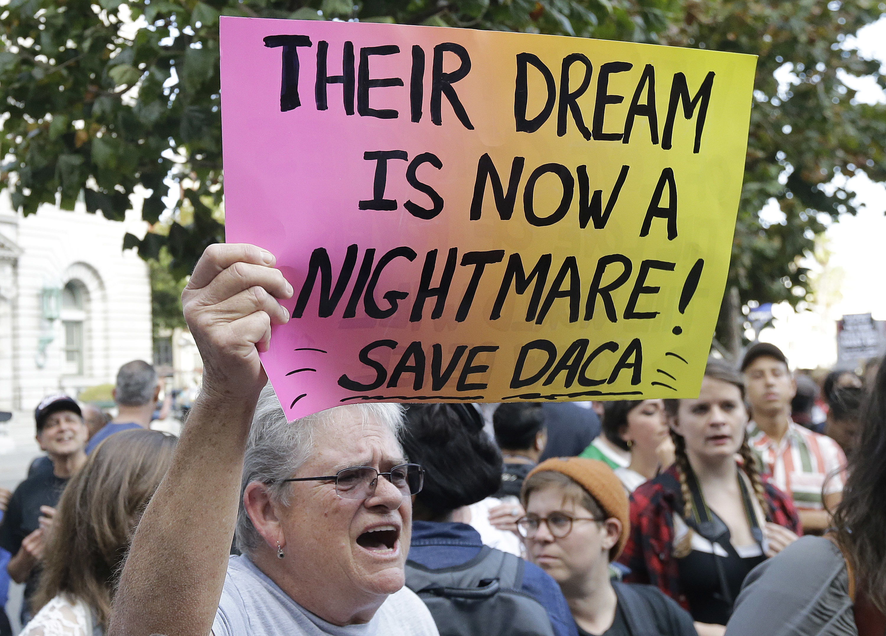 Judy Weatherly, a supporter of the Deferred Action for Childhood Arrivals (DACA), holds up a sign during a protest outside of the Federal Building in San Francisco, Sept. 5, 2017.