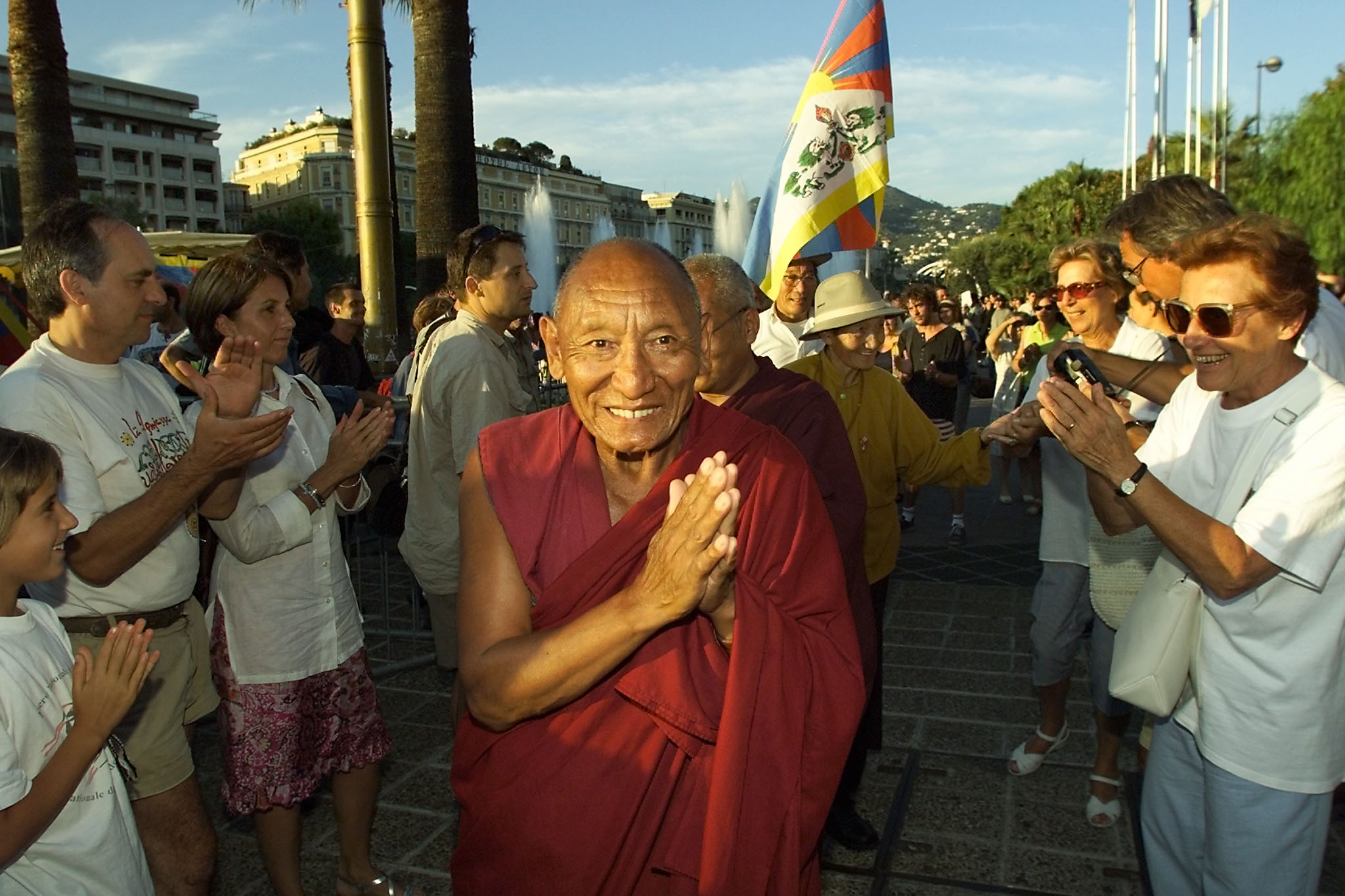 FILE - Tibetan monk Palden Gyatso, a political prisoner for decades in China, makes a gesture of prayer, July 9, 2000, in Nice, France, to a crowd that came to show support for him.