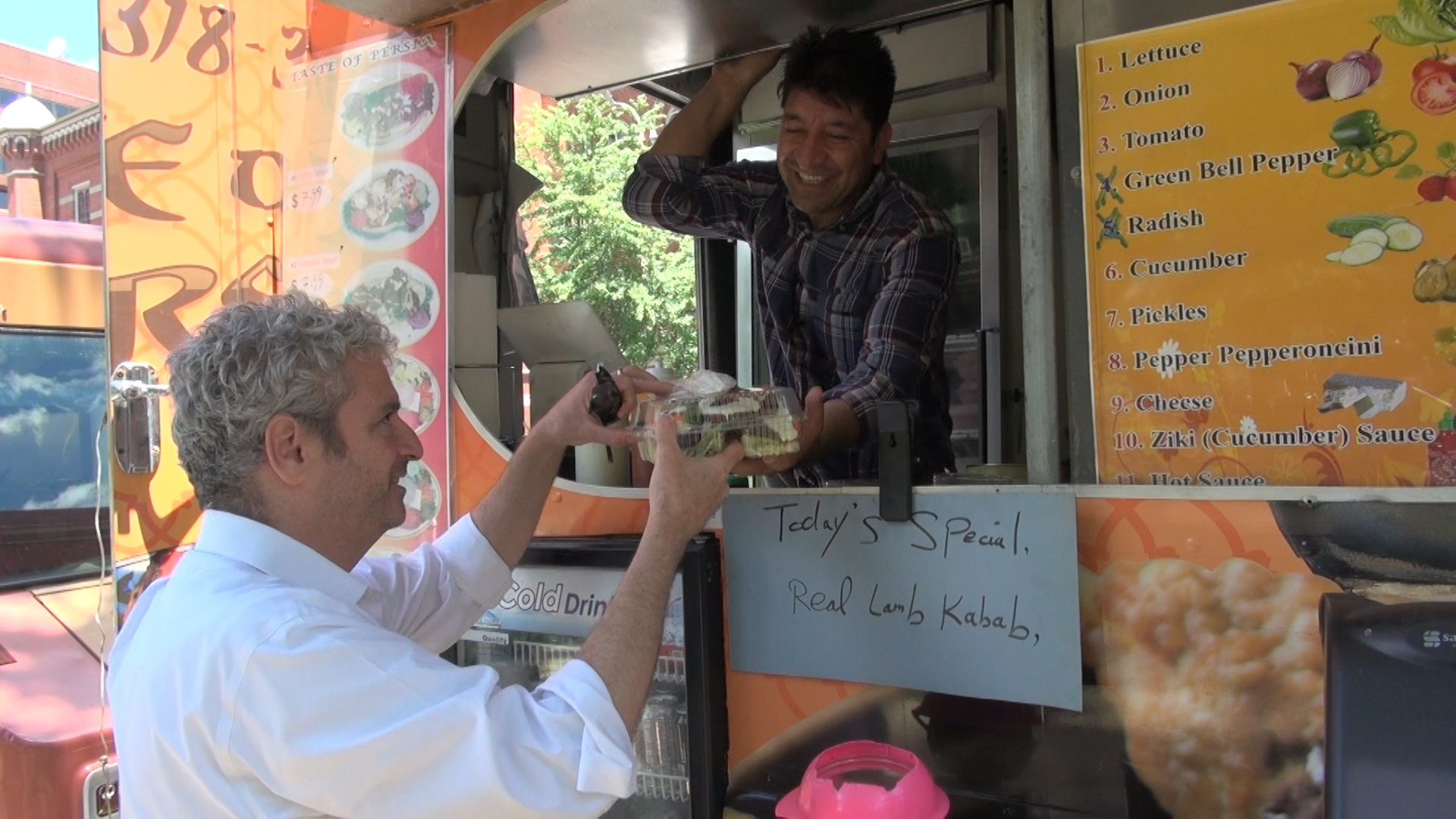 After considerable searching, Dowlati found work at a food truck. While he continues to look for an office job, he hopes to stay on with the truck. (J. Soh/VOA)
