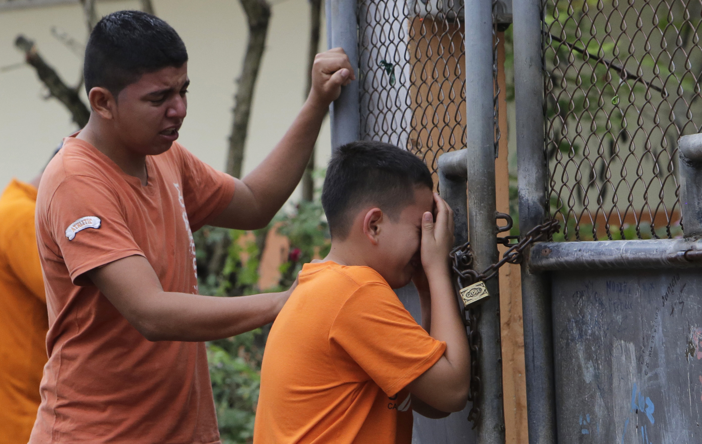 Boys cry as he finds out that their sister has been killed in an earthquake in Pedernales, Ecuador, April 17, 2016.
