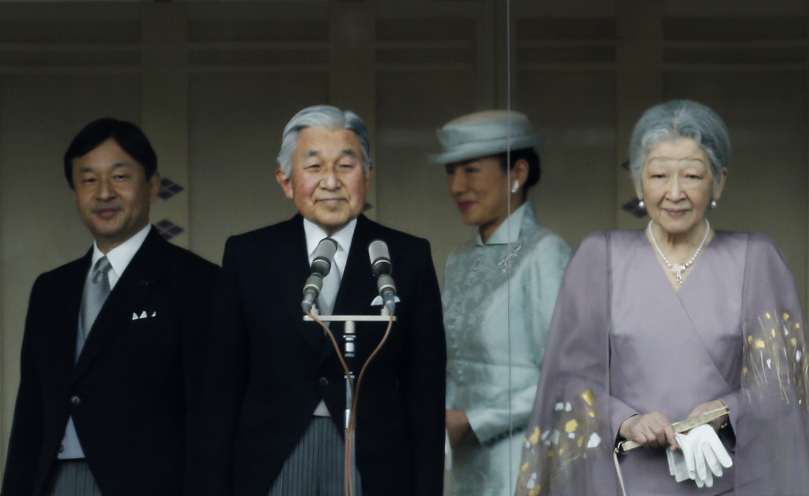Japan's Crown Prince Naruhito (L-R), Emperor Akihito, Crown Princess Masako and Empress Michiko stand in front of well-wishers who gathered to celebrate the monarch's 80th birthday at the Imperial Palace in Tokyo December 23, 2013. REUTERS/Yuya Shino...