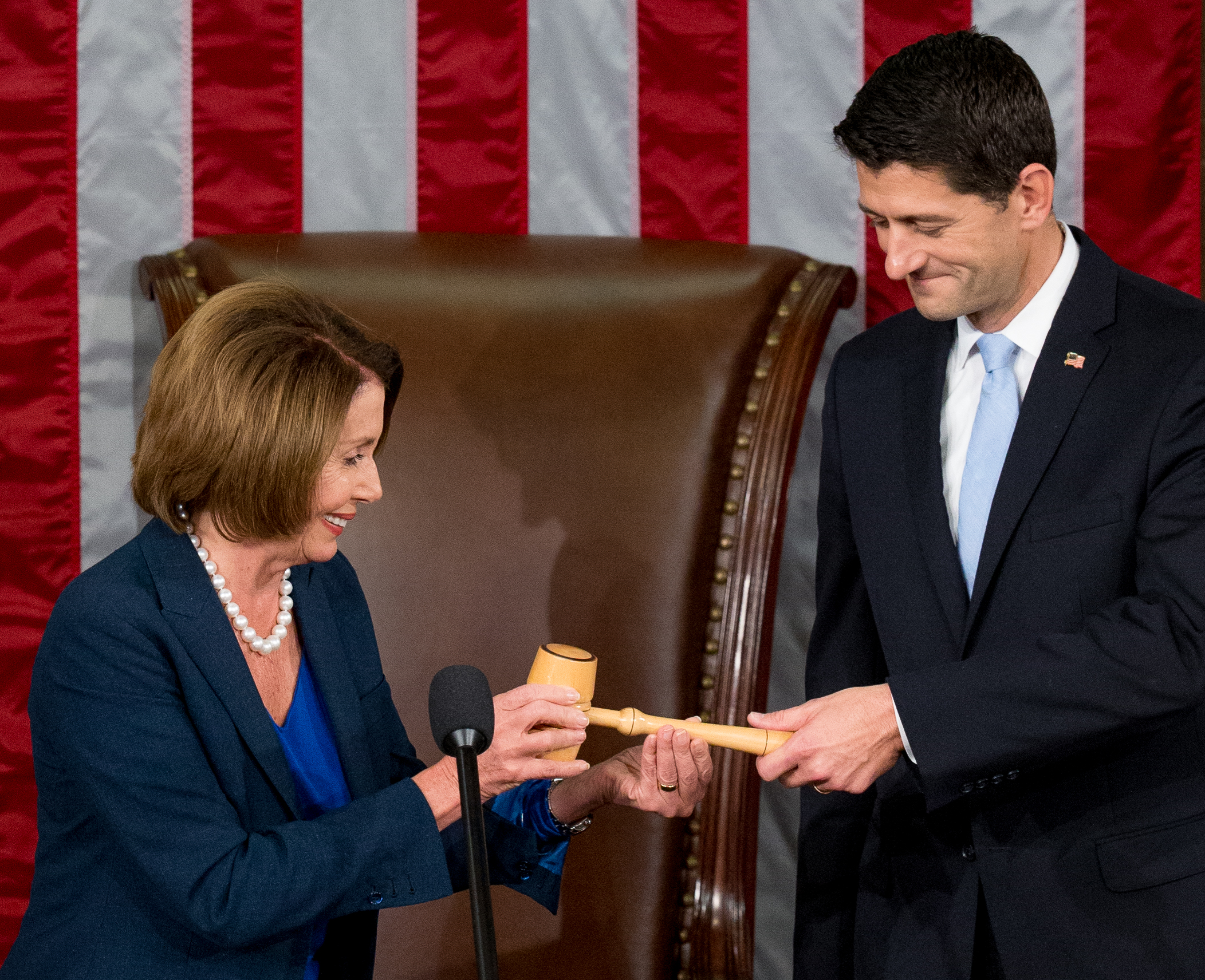 Newly elected House Speaker Paul Ryan of Wis., receives the Speaker's gavel from House Minority Leader Nancy Pelosi of Calif., in the House Chamber on Capitol Hill in Washington, Oct. 29, 2015.
