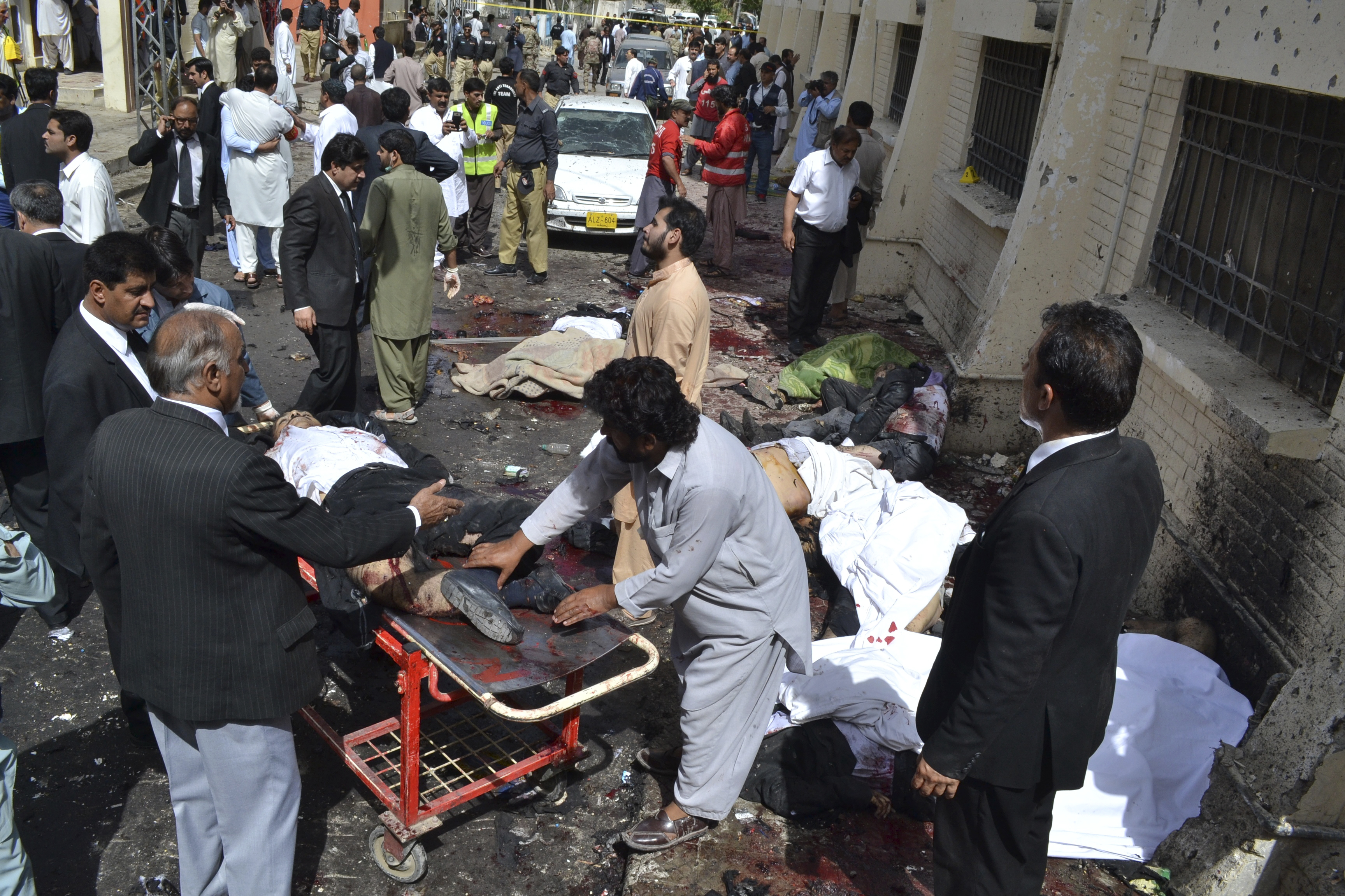 People help victims of a bomb blast in Quetta, Pakistan, Monday, Aug. 8, 2016.