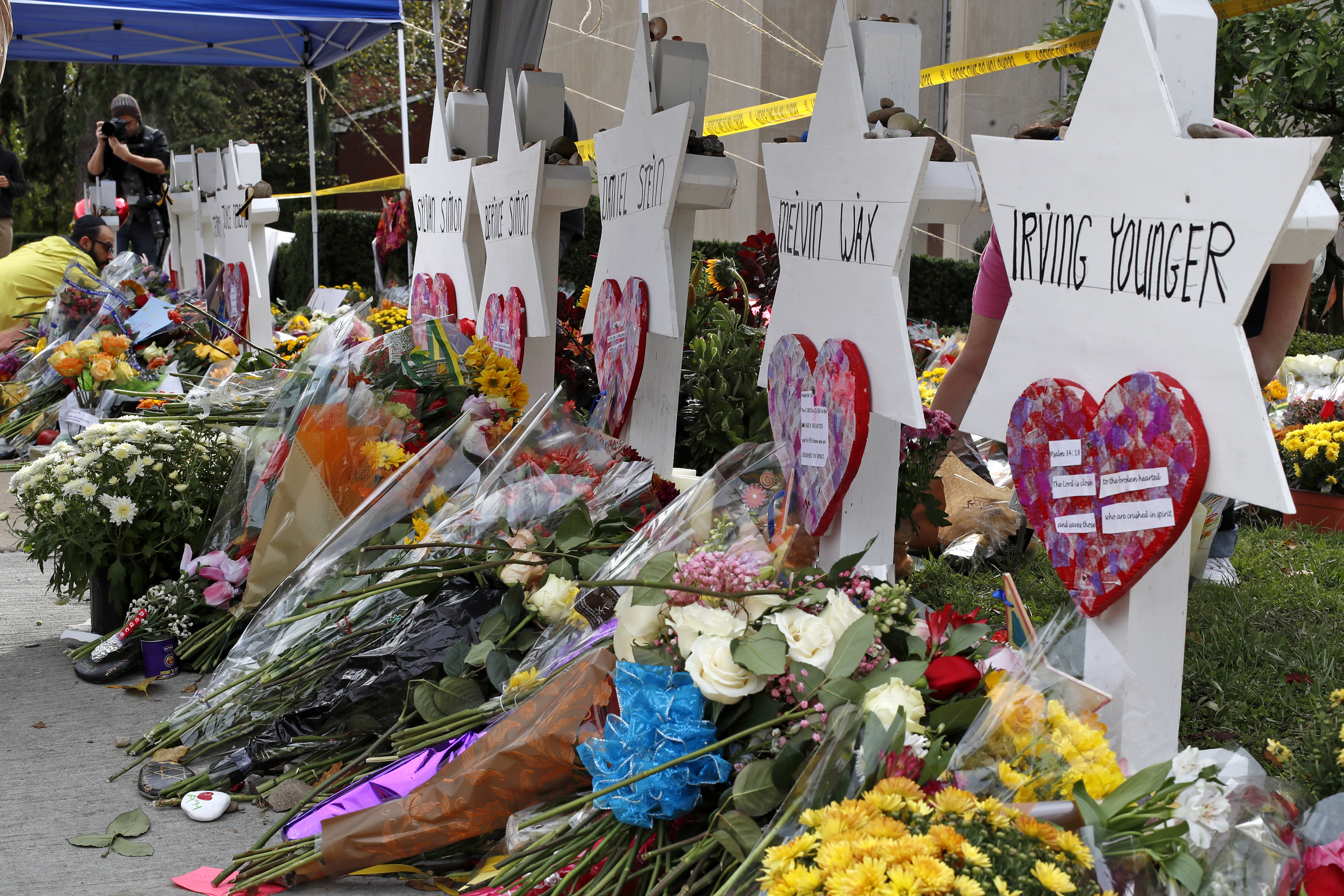 Flowers surround Stars of David on Oct. 31, 2018, part of a makeshift memorial outside the Tree of Life Synagogue to the 11 people killed during worship services Saturday in Pittsburgh.