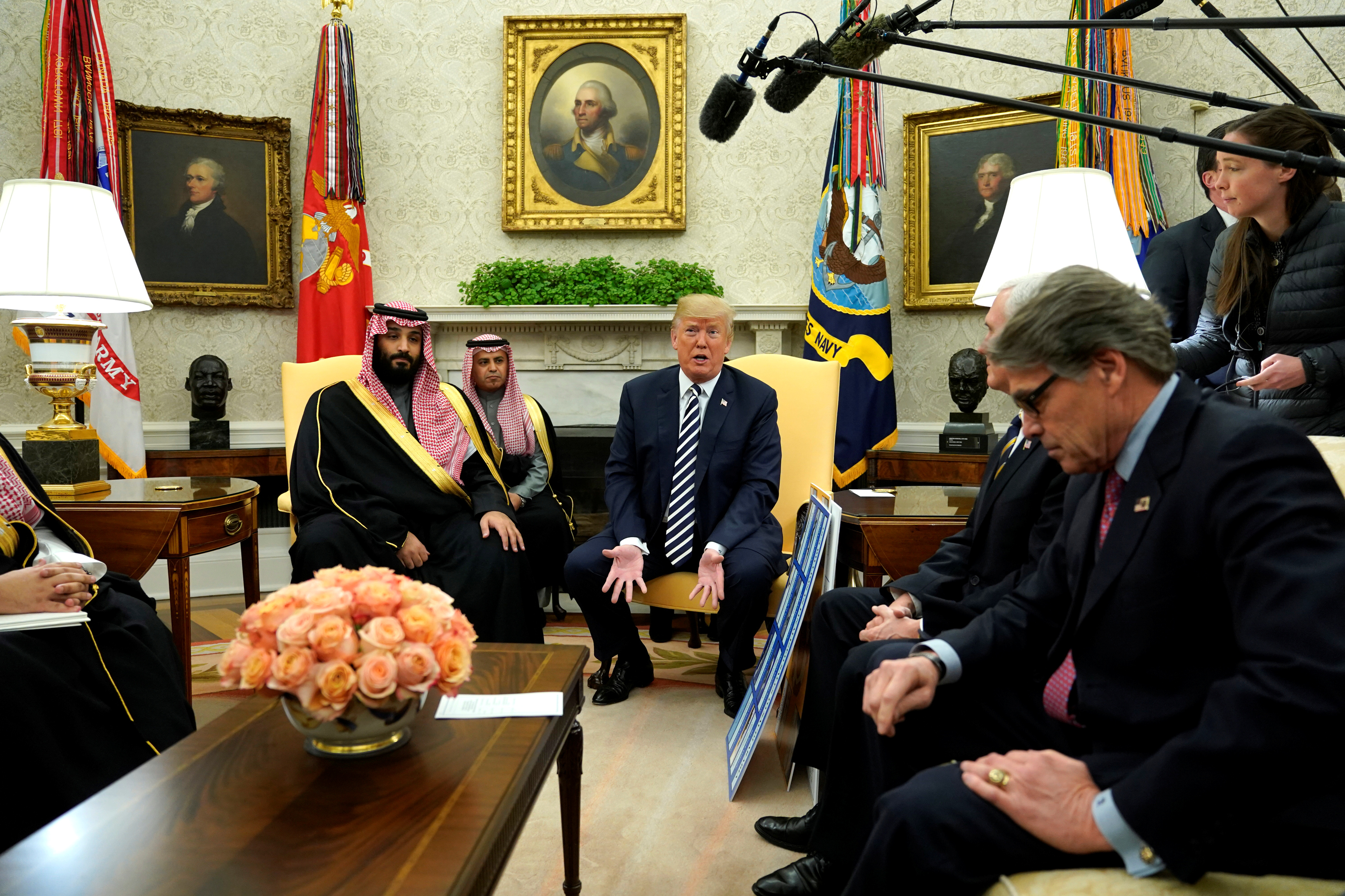 U.S. President Donald Trump, flanked by Energy SecretaryRick Perry, delivers remarks as he welcomes Saudi Arabia's Crown Prince Mohammed bin Salman in the Oval Office at the White House in Washington, March 20, 2018.