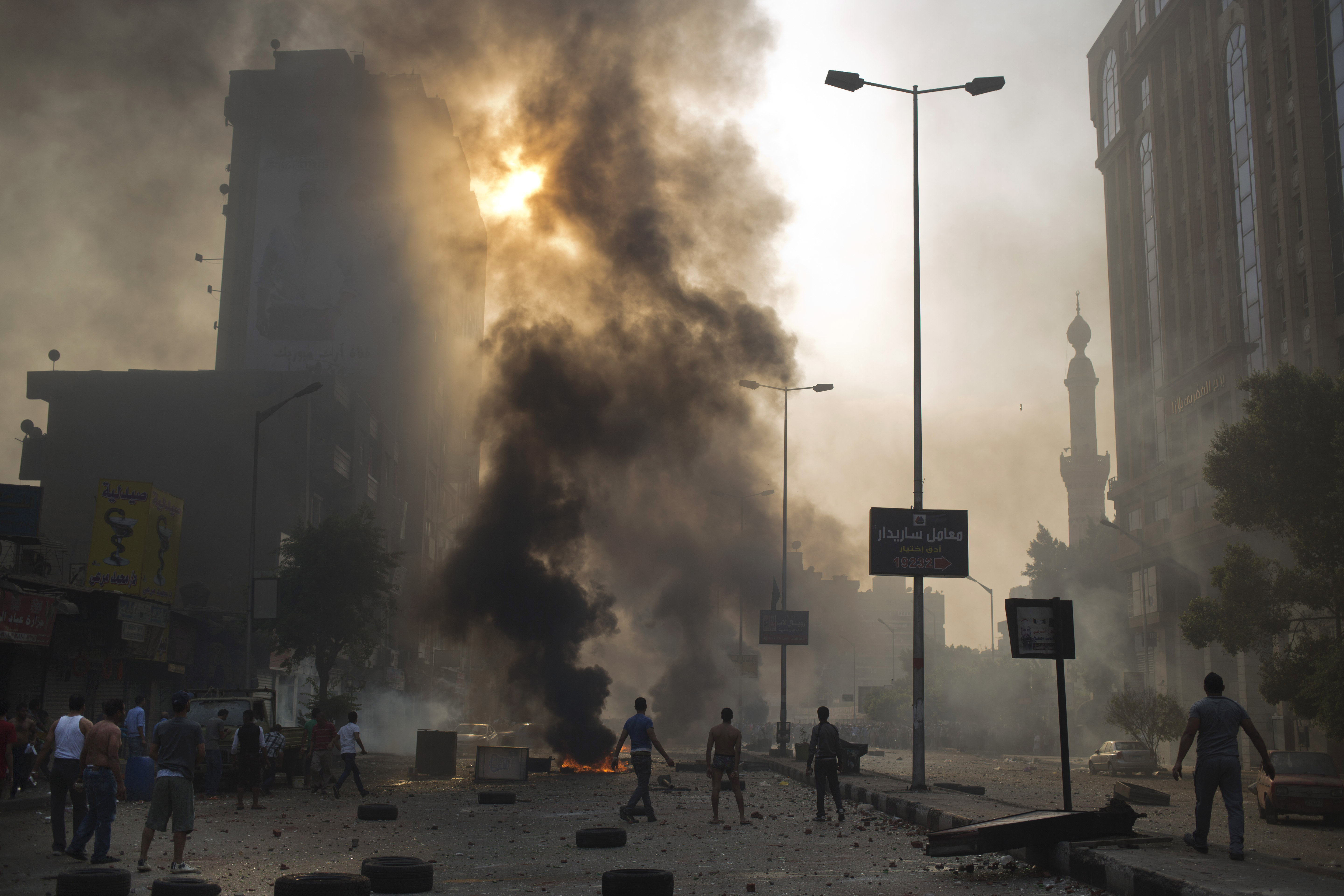 Supporters and opponents of Egypt's ousted Islamist President Mohamed Morsi clash in Cairo, Oct. 6, 2013.