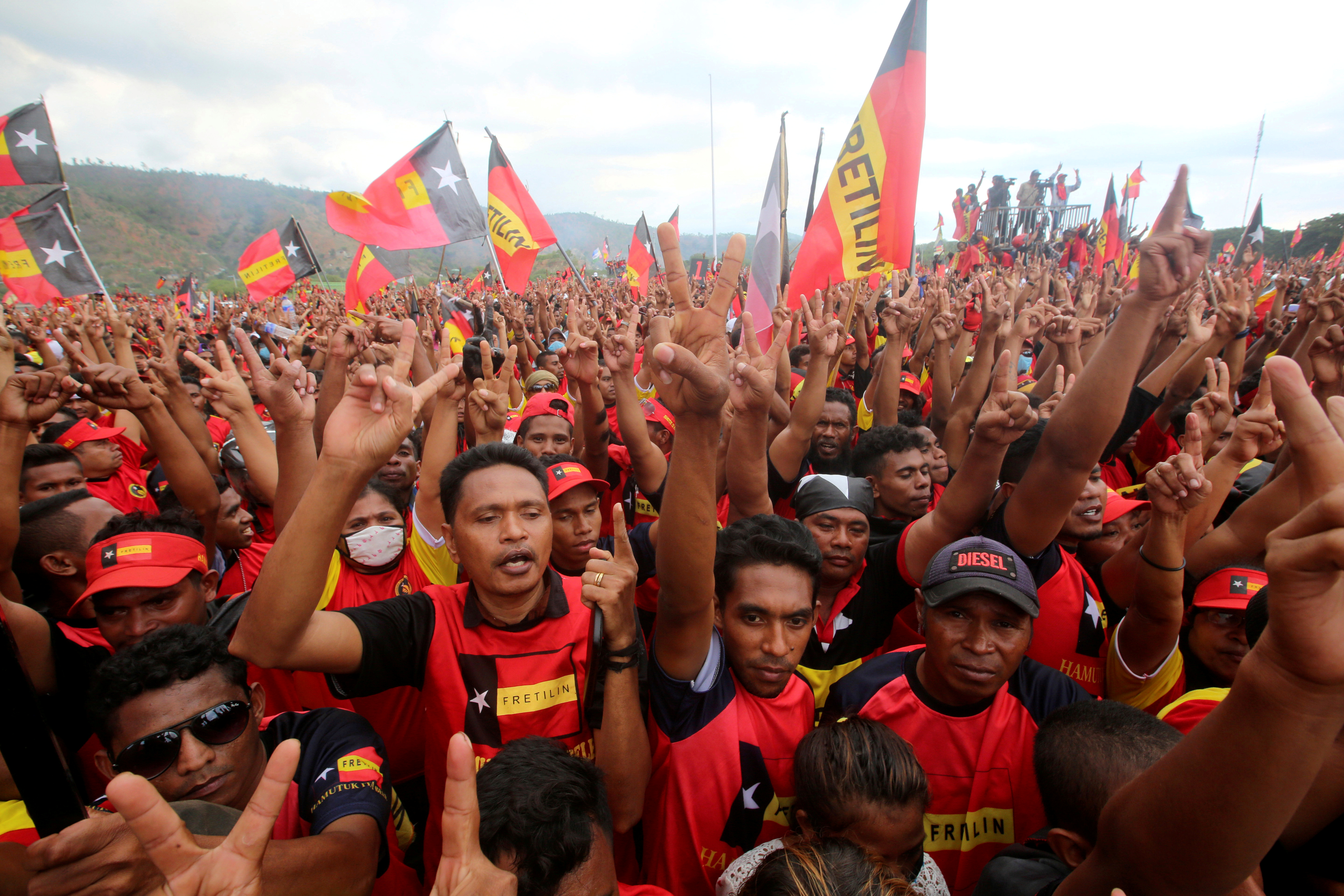 Supporters of the Revolutionary Front for an Independent East Timor (FRETILIN) political party shout during a rally on the last day of campaigning ahead of this weekend's parliamentary elections in Dili, East Timor, July 19, 2017.